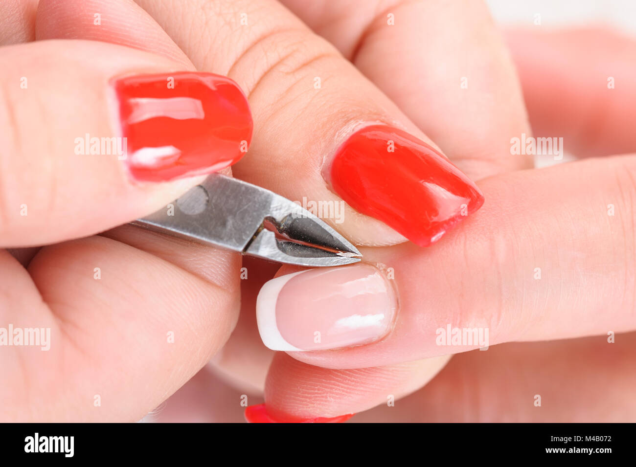 Cuticles cutting with nail clippers Stock Photo, Royalty Free Image ...