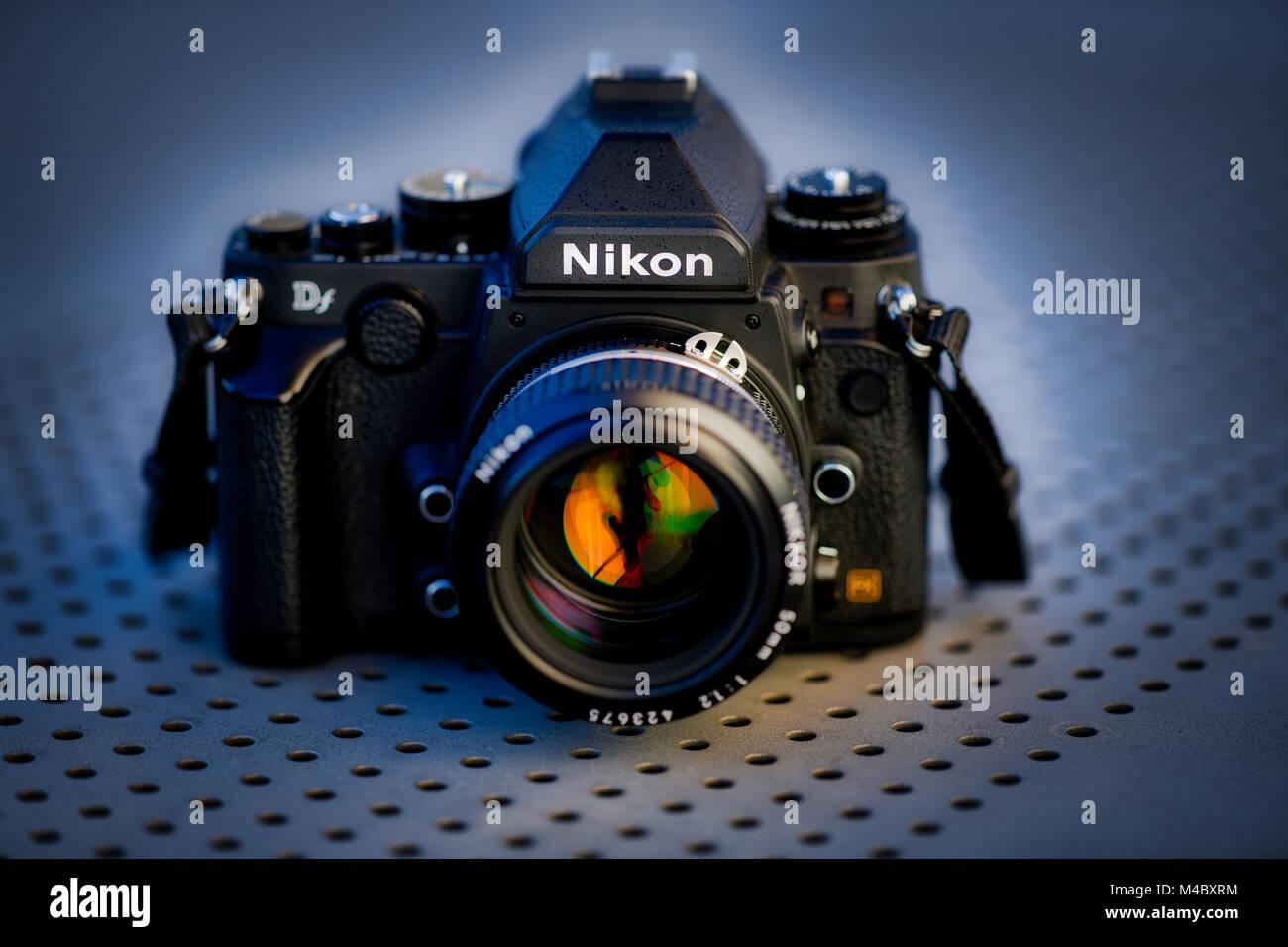 dslr nikon df with nikkor ai s 50mm 1 2 in retro style studio shot