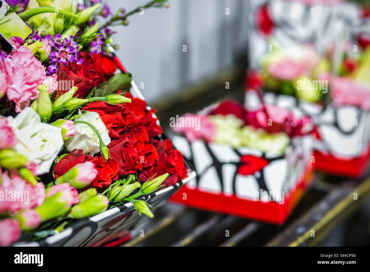Beautiful bouquet of fresh flowers in boxes florist service concept beautiful bouquet of fresh flowers in boxes florist service concept retail and gross cut flower store concept flowermarket background izmirmasajfo