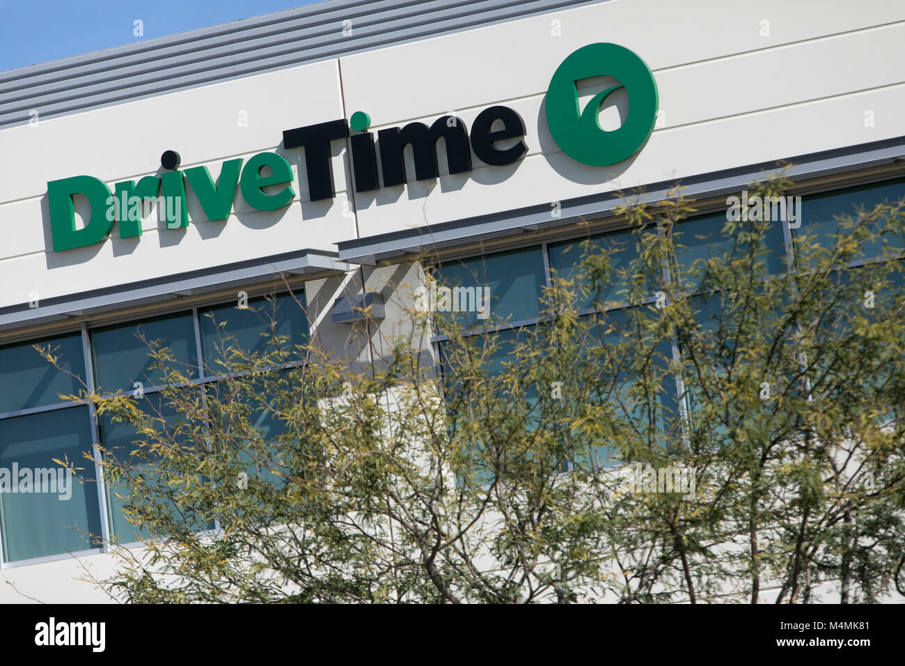 A Logo Sign Outside Of The Headquarters Of The Drivetime Automotive