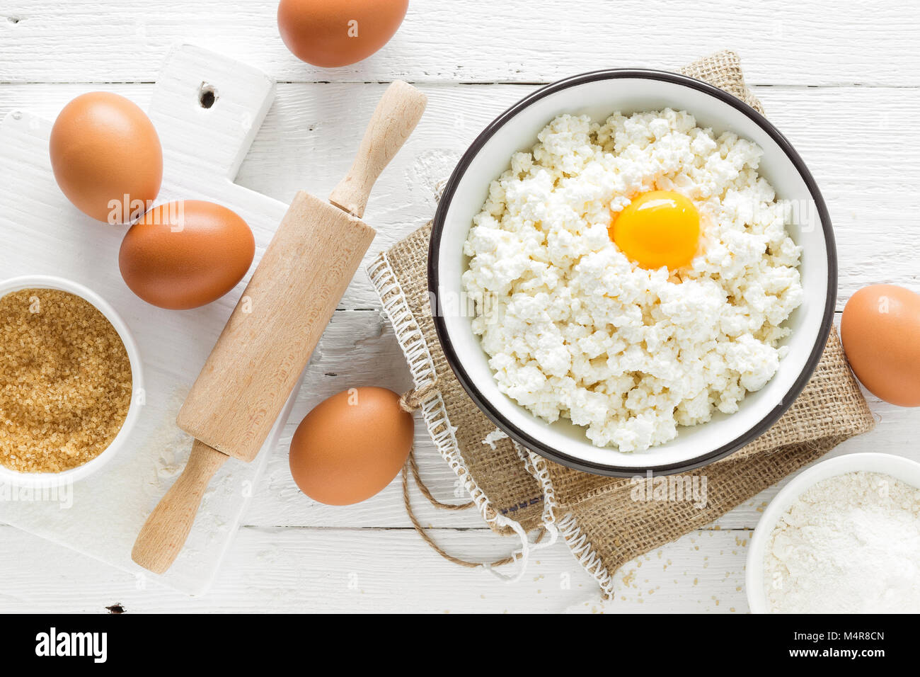 Culinary Background With Ingredients For Cooking, Cottage Cheese, Baking  Flour, Sugar And Eggs