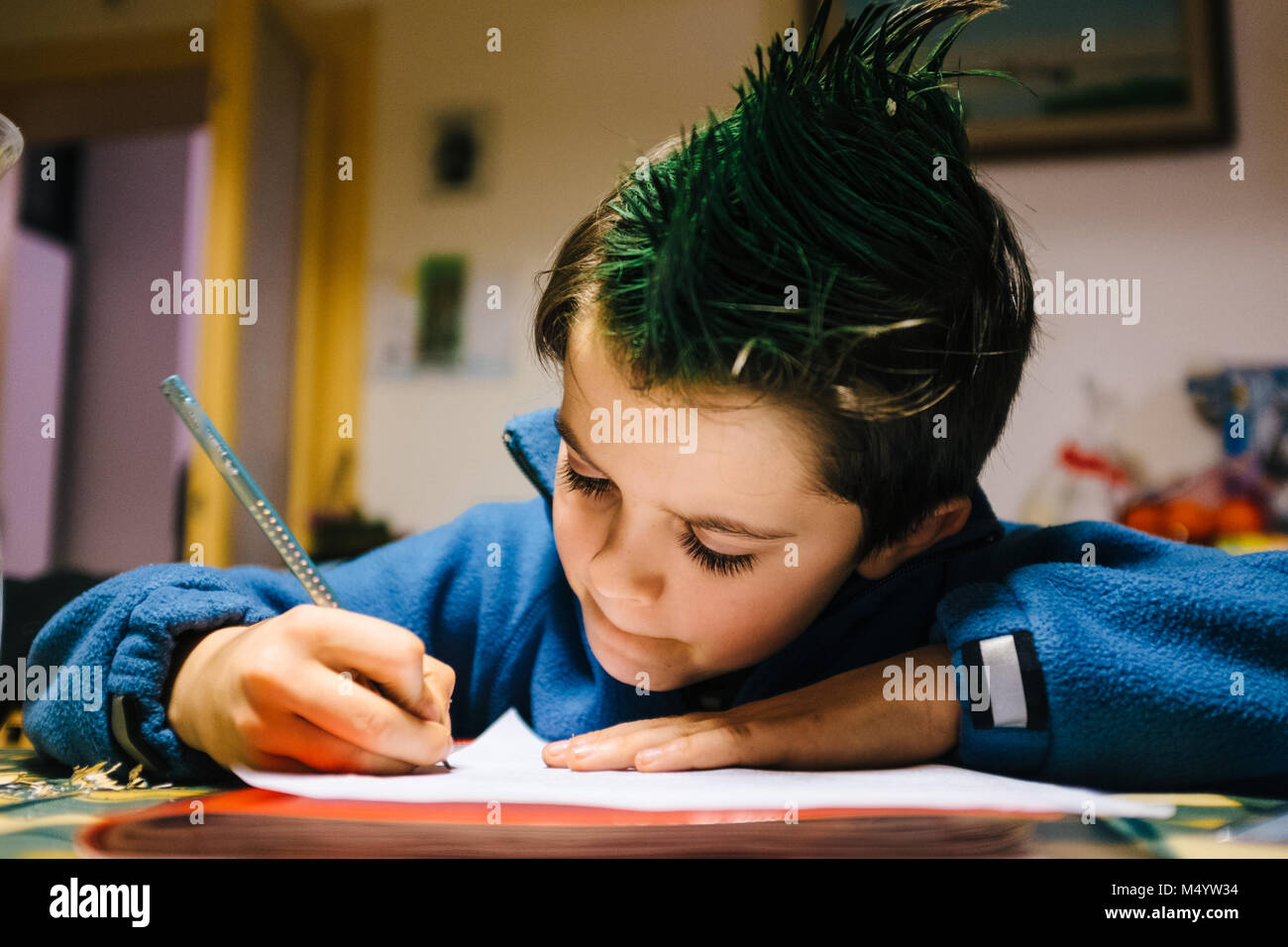 Portrait Of 9 Year Old Boy At Home With Green Colored Hair Crest