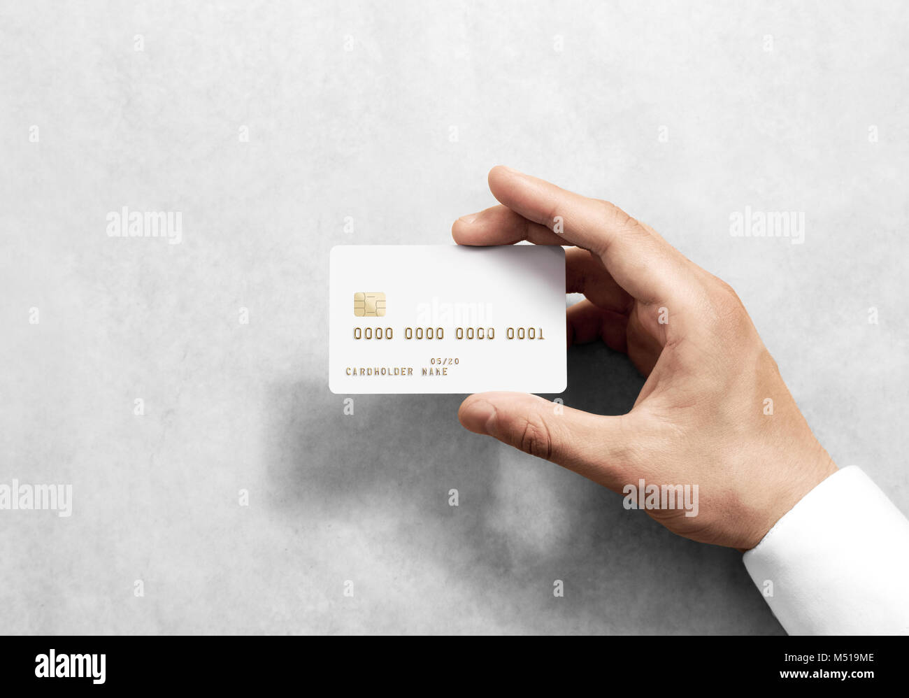 Hand holding blank white credit card mockup with chip and embossed ...