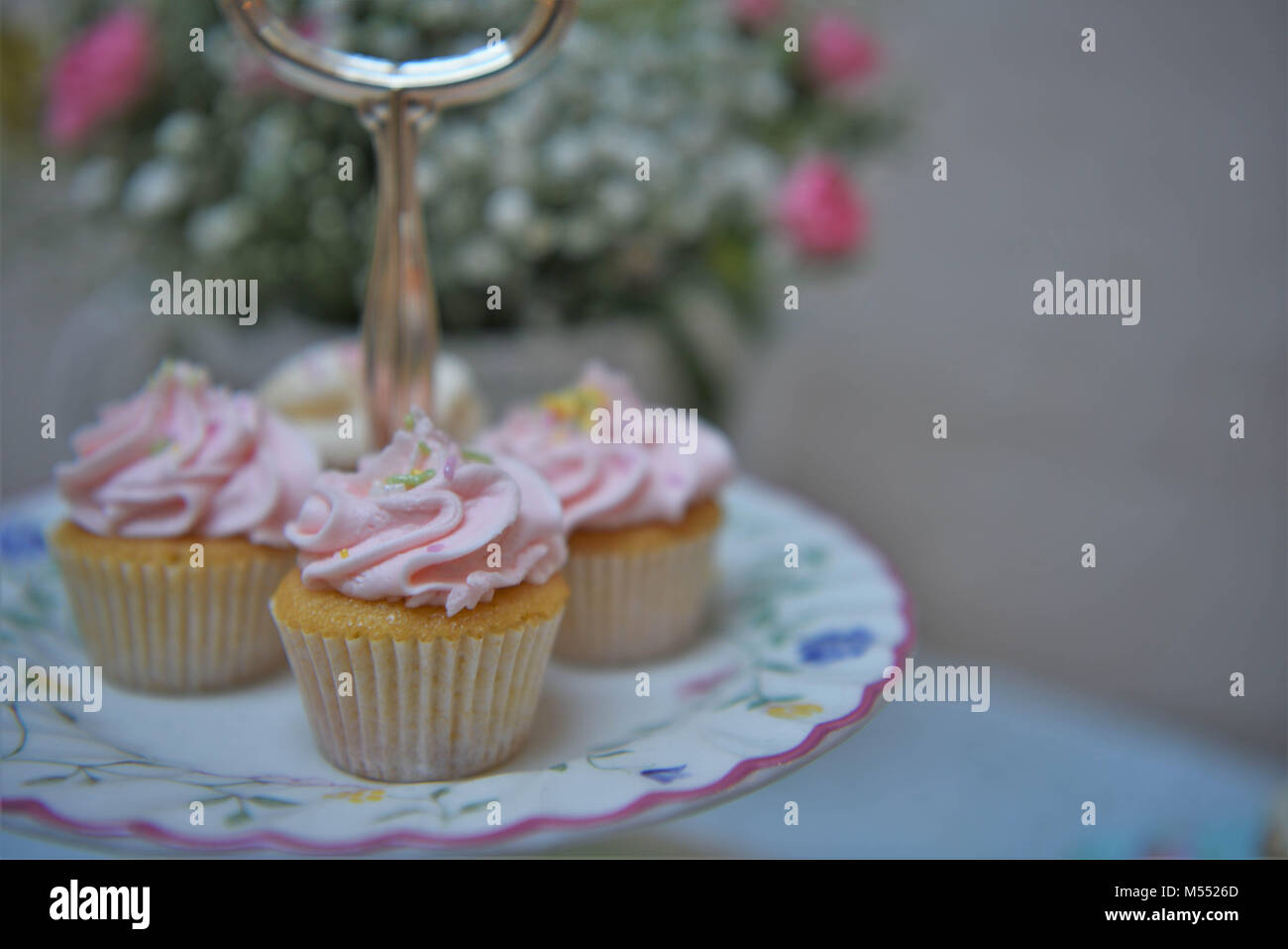 Food Of Cupcakes On A Vintage Cake Stand With Fresh Flowers Stock