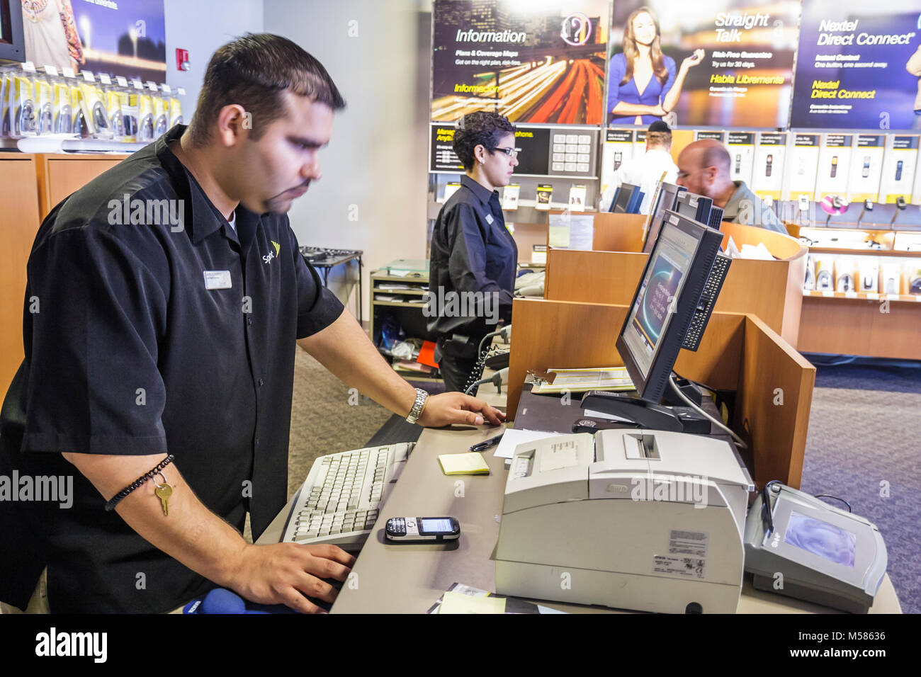 Sprint nextel store mobile cell phone clerk computer hispanic man sprint nextel store mobile cell phone clerk computer hispanic man employment brand name marketing customer sales counter biocorpaavc Image collections