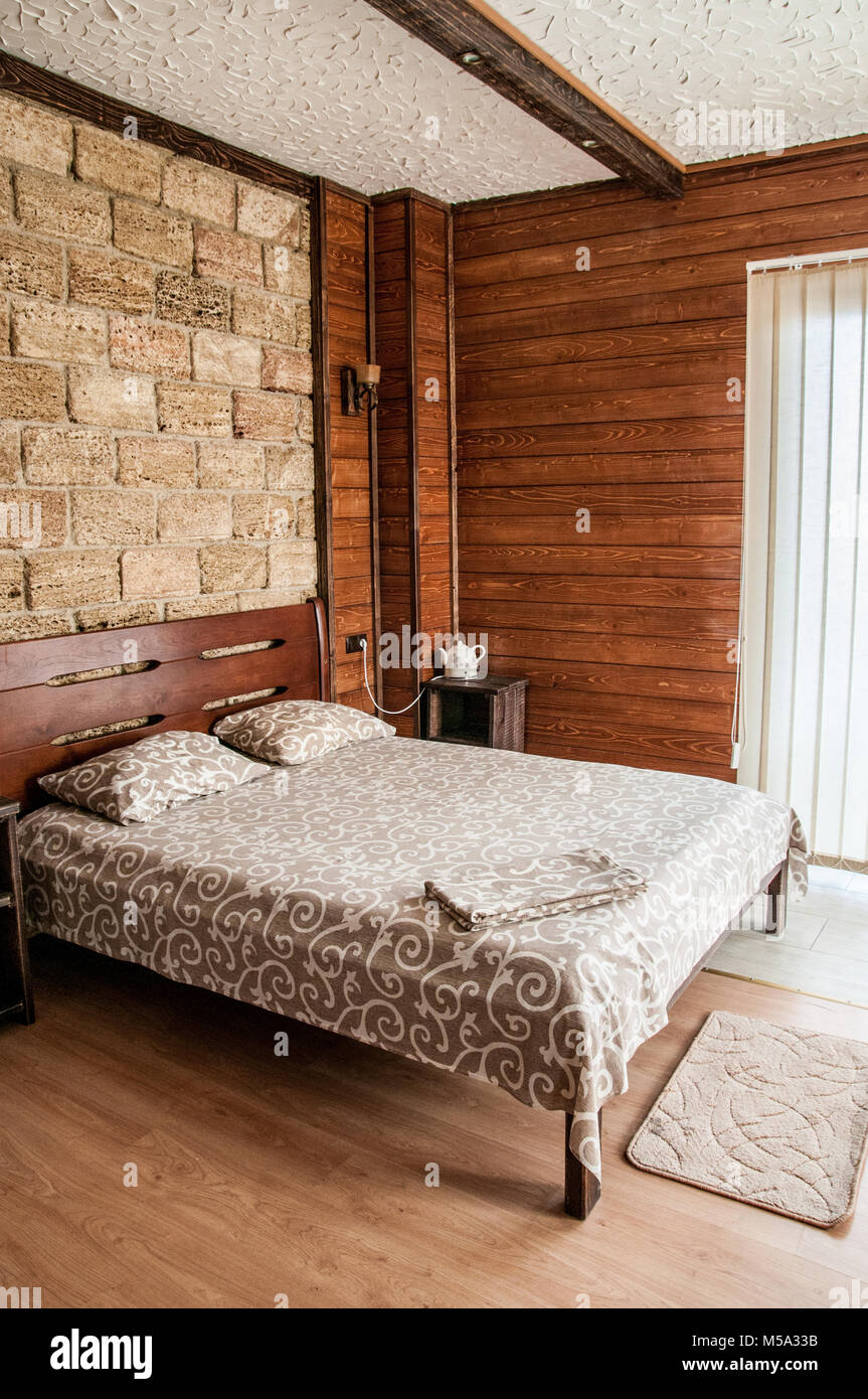 Comfort Bedroom In Luxury Style. Scandinavian Style Stone And Natural Wood.