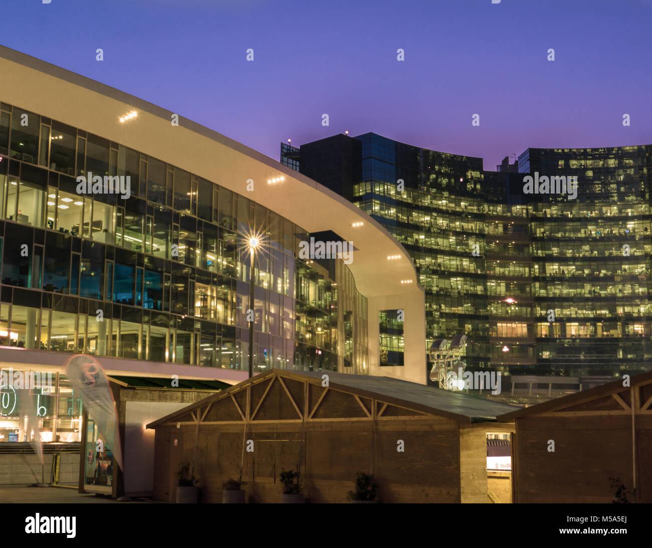 rounded lines of modern buildings in milan italy stock photo