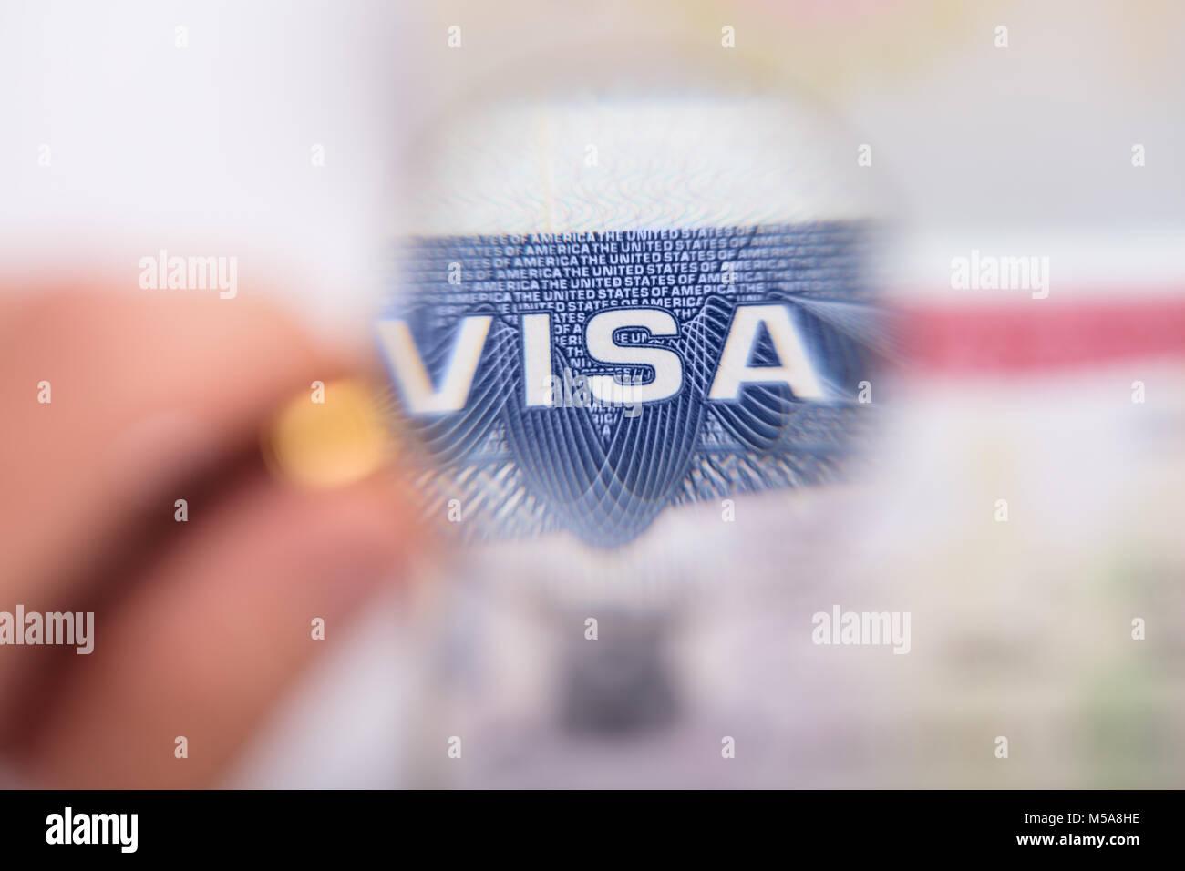 Human hand zooming at visa text with magnifying glass stock photo human hand zooming at visa text with magnifying glass biocorpaavc Choice Image