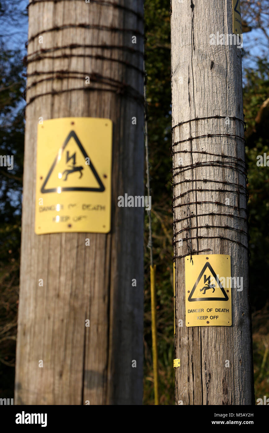 Barbed Wire Signs | Electricity Pylons With Danger Of Death Signs And Barbed Wire In