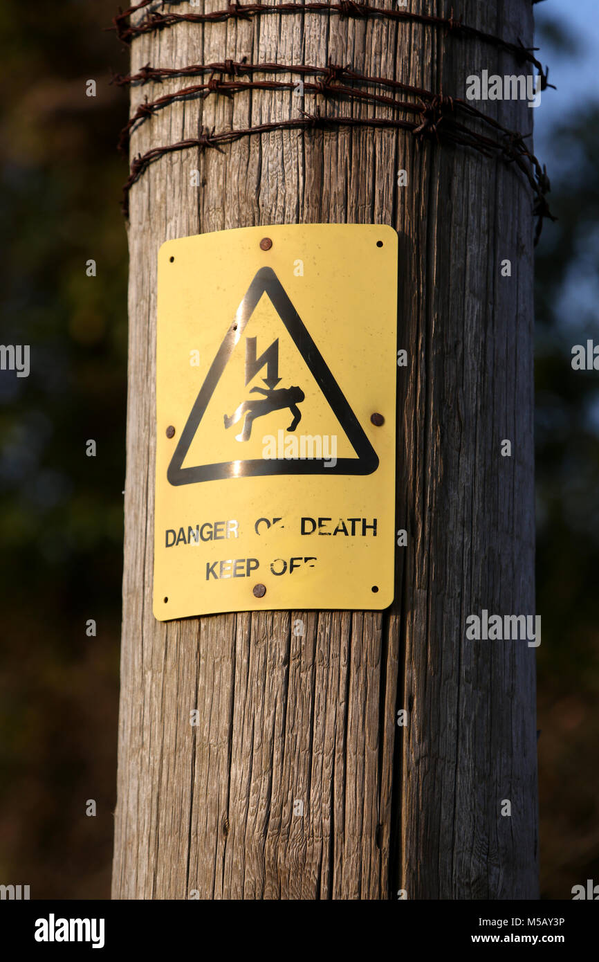 Barbed Wire Signs   Electricity Pylons With Danger Of Death Signs And Barbed Wire In