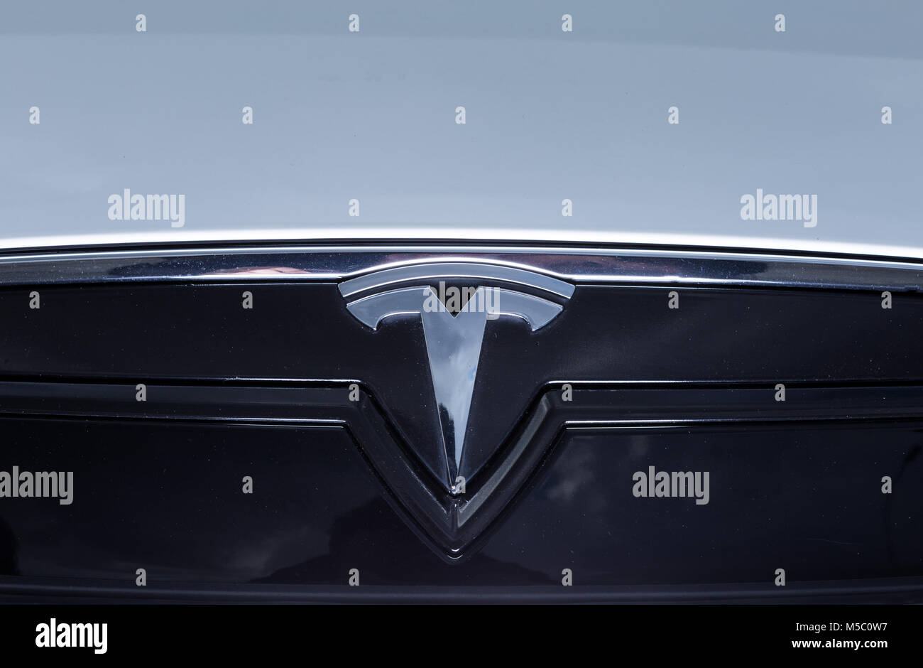 Front logo on tesla electric car as the symbol of future eco stock front logo on tesla electric car as the symbol of future eco alternative fuel solution concept buycottarizona Gallery