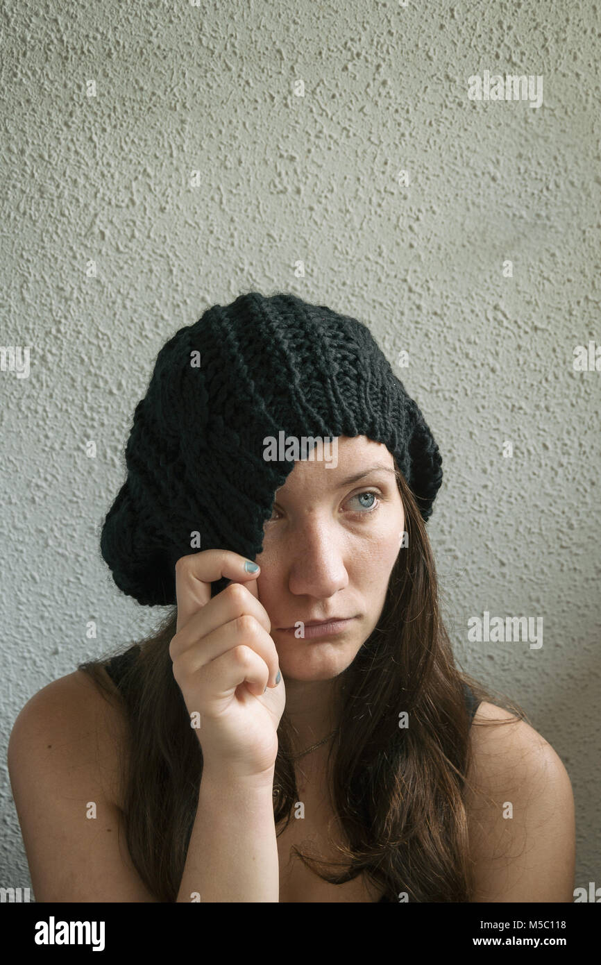 1736d59c26a girl with long hair and blue eyes partially covering her face with her hat