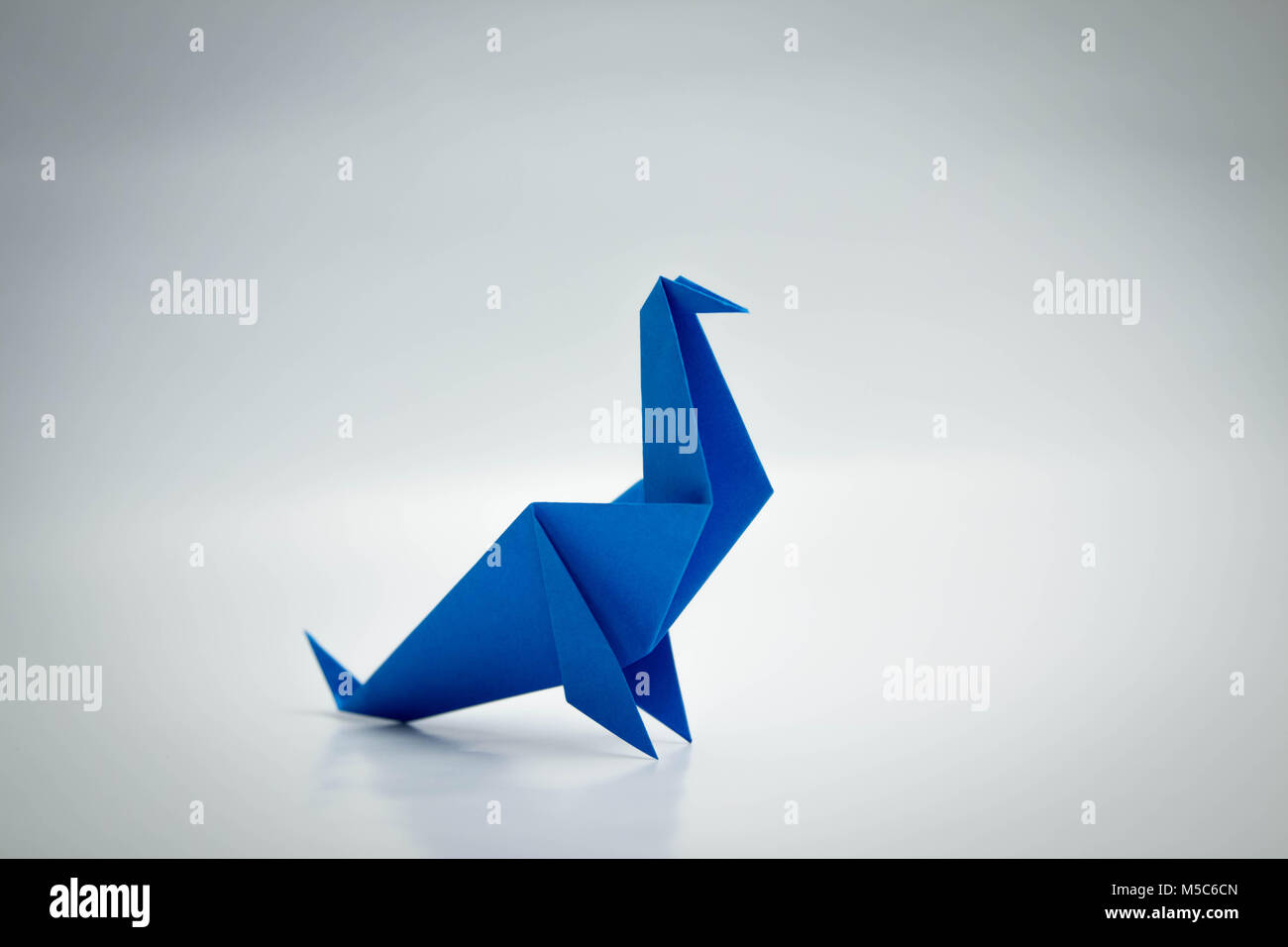 Origami seal stock photos origami seal stock images alamy blue seal origami isolated on white stock image jeuxipadfo Gallery