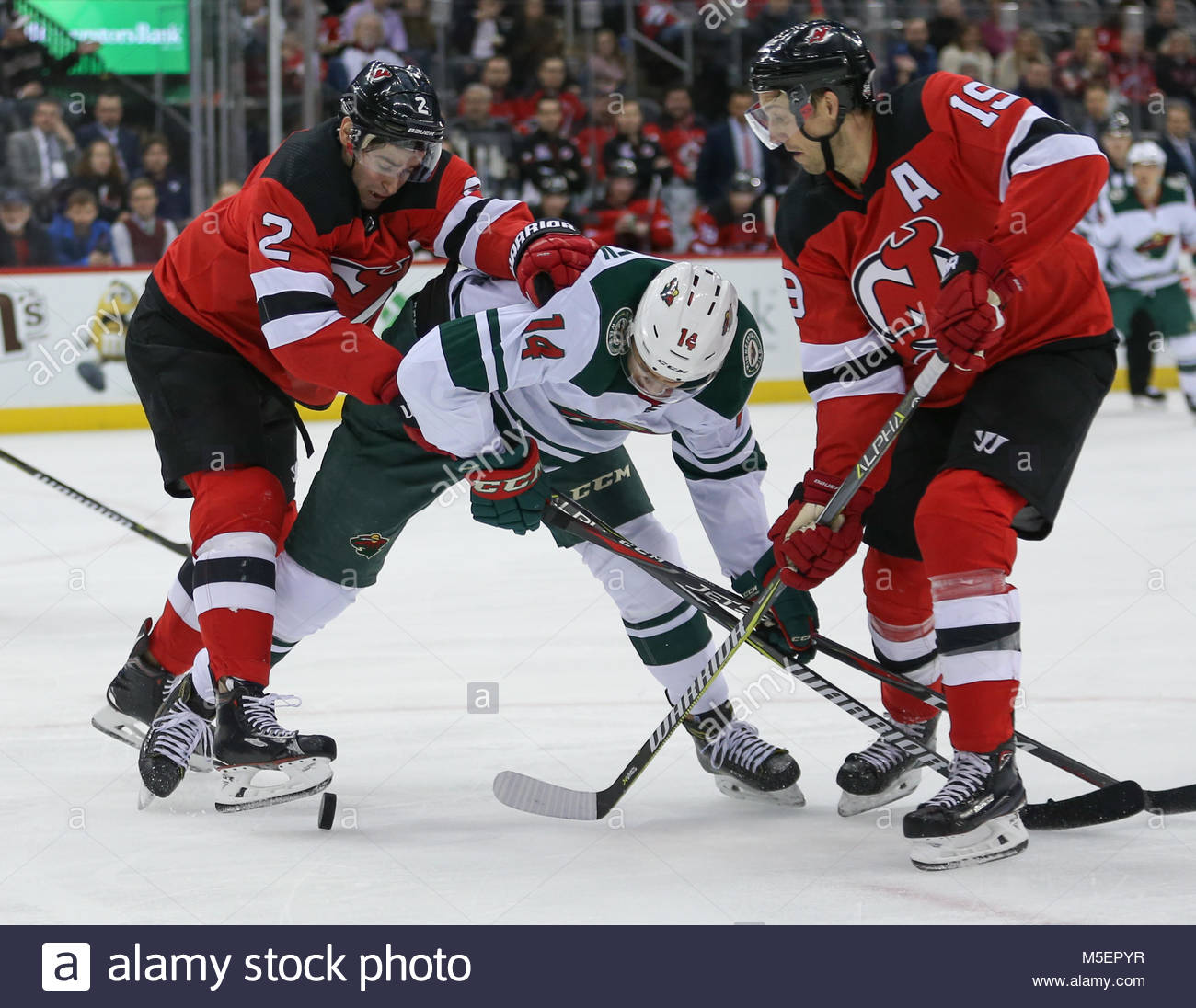 ... away womens nhl 3f175 968c1  coupon new jersey devils defenseman john  moore 2 and new jersey devils center travis zajac 19 c747139db