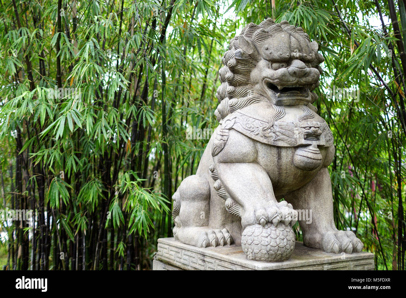 A Stone Lion Statue At The Gardens By The Bay In Singapore