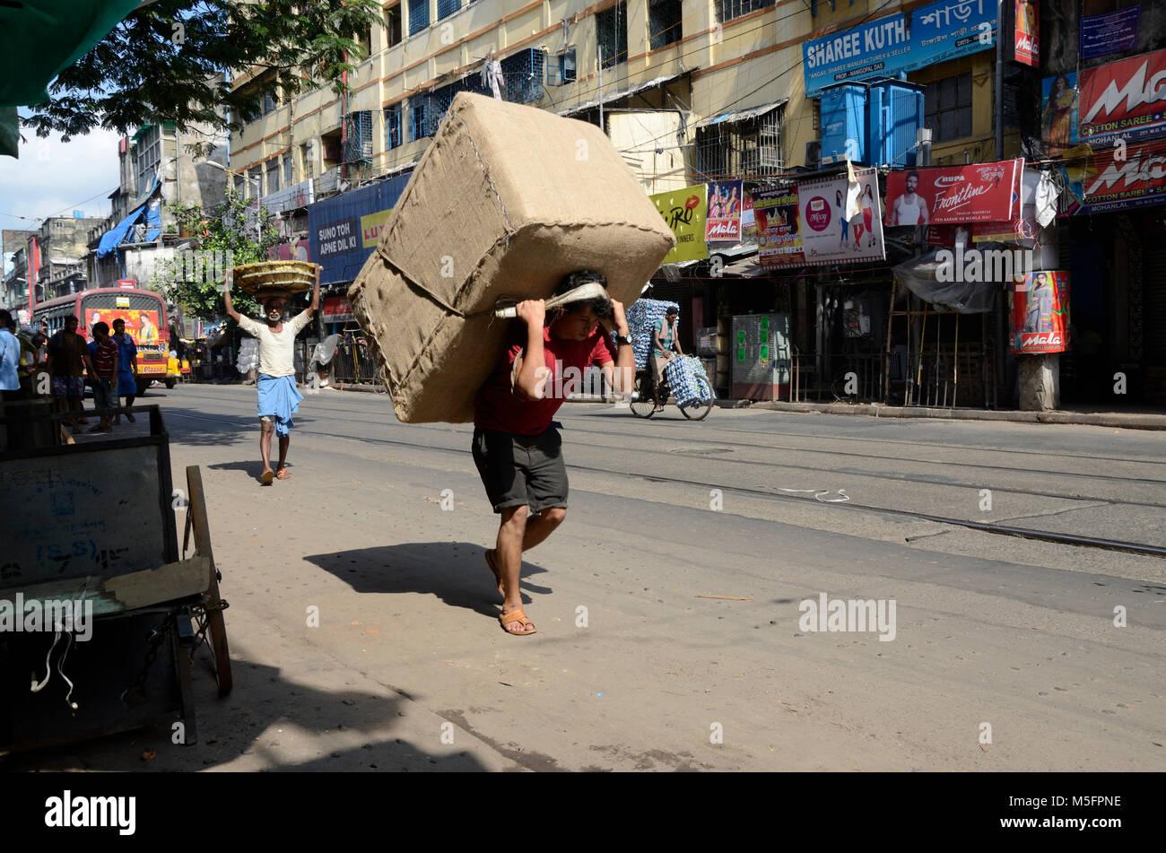 man carrying huge jute bag kolkata west bengal india stock photo