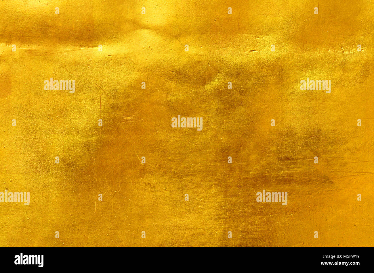 Gold color metal wall surface texture, a closeup photo image on ...