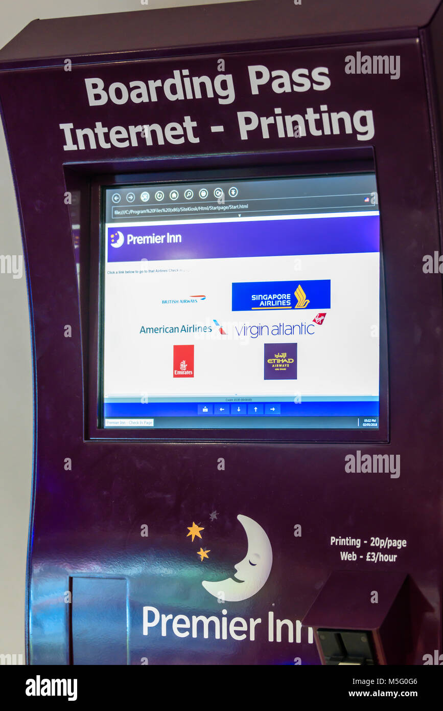 Coin Operated Boarding Pass Printer At A Premier Inn Hotel Stock