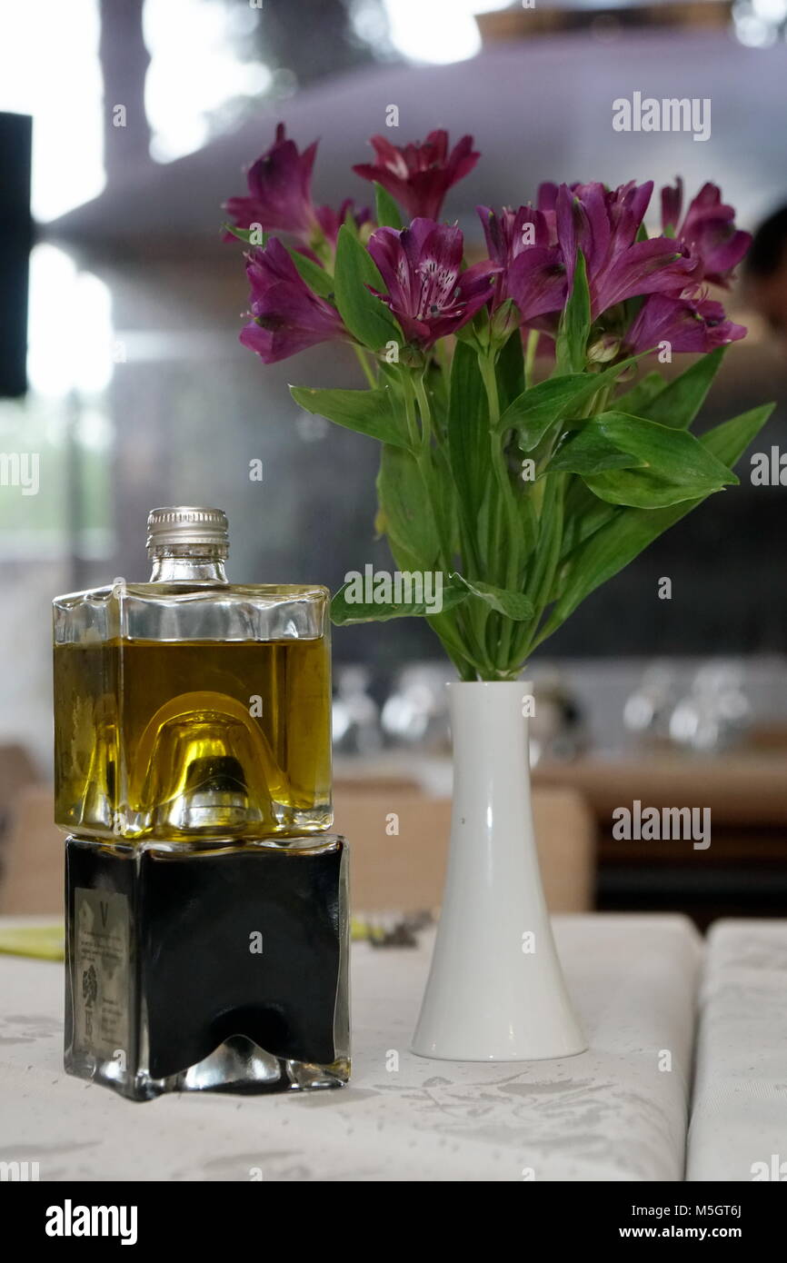 Balsamic vinegar and olive oil nearby vase with flowers oil and balsamic vinegar and olive oil nearby vase with flowers oil and vinegar on a table in the nearby vase with flowers reviewsmspy