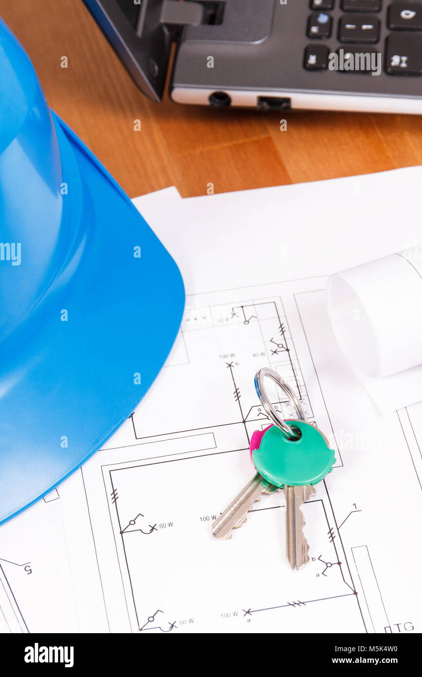home keys, diagrams or electrical construction drawings with laptophome keys, diagrams or electrical construction drawings with laptop and protective helmet for engineer jobs, building home concept