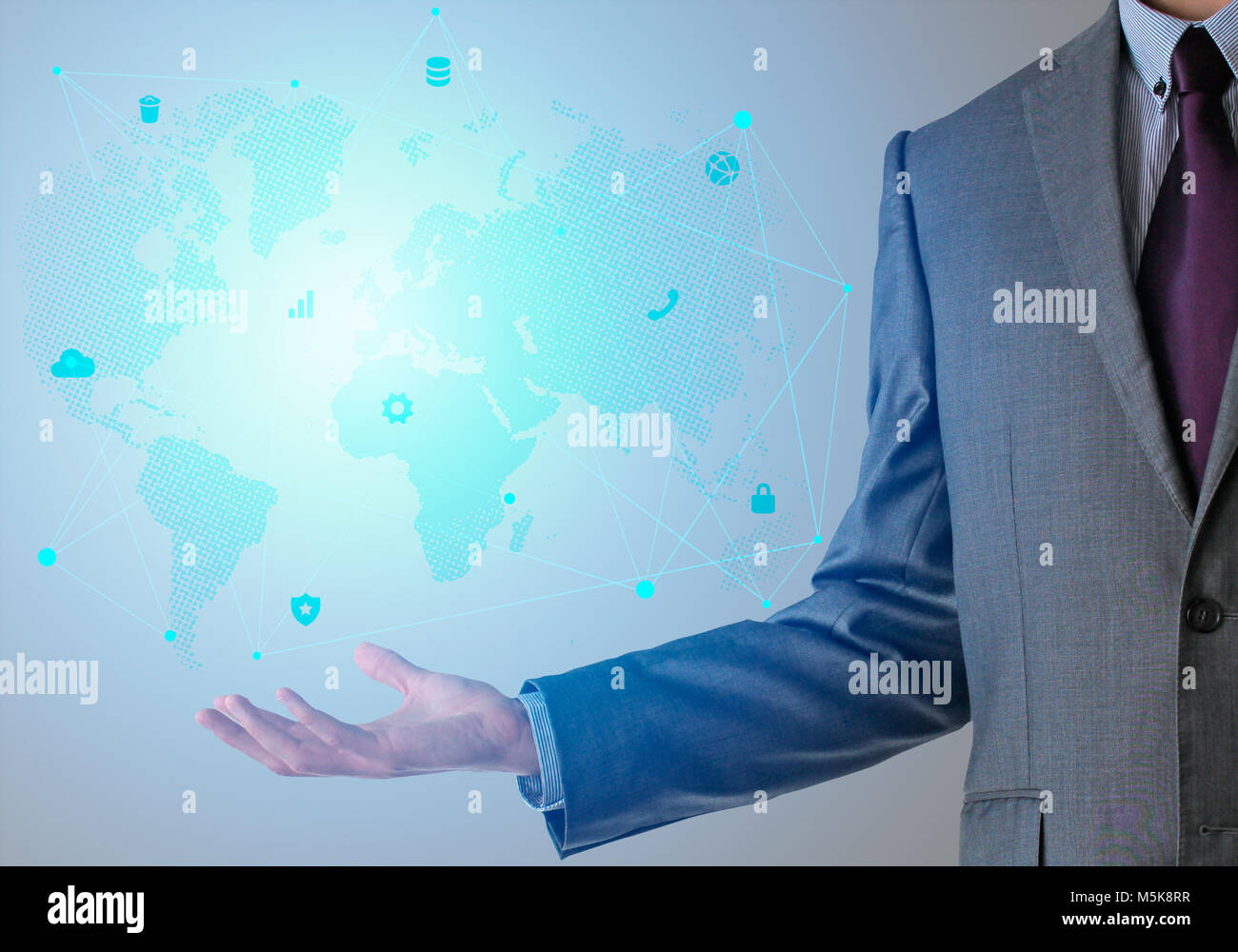 Businessman in suit with world map and icons in blue color stock businessman in suit with world map and icons in blue color gumiabroncs Gallery
