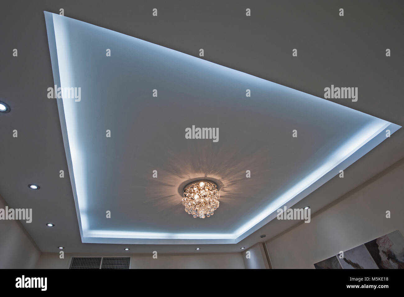 Ornate chandelier style ceiling light inside luxury apartment with ornate chandelier style ceiling light inside luxury apartment with led lighting surround mozeypictures Choice Image