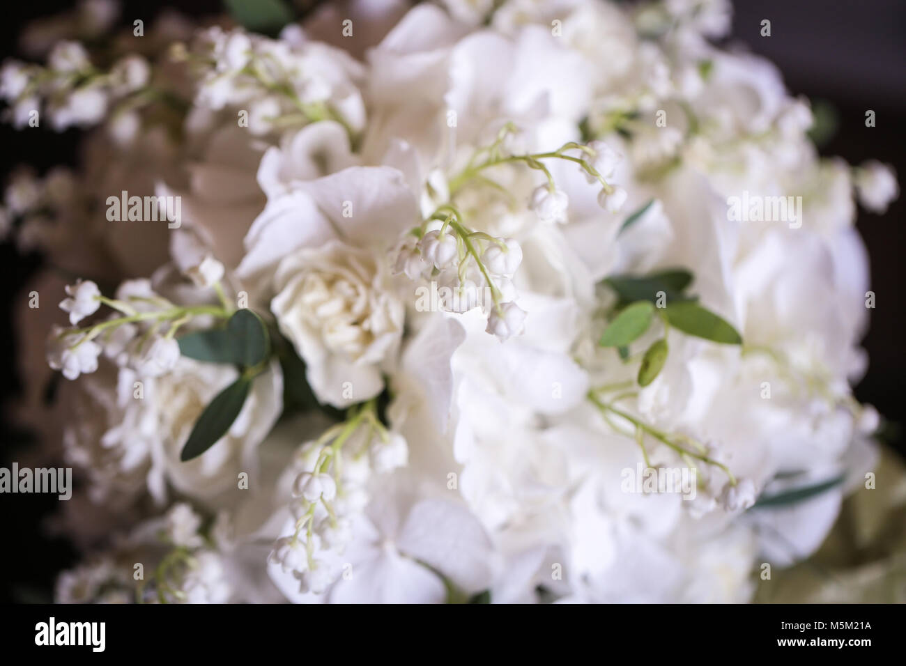 Wedding Bouquet Of White Small Flowers Lily Of The Valley At Girls