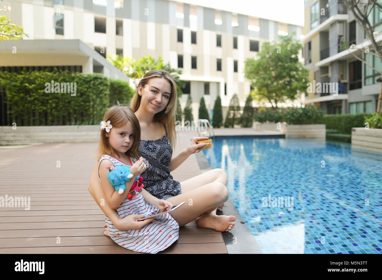 Mother daughter near swimming pool stock photos mother for Mother daughter vacation destinations