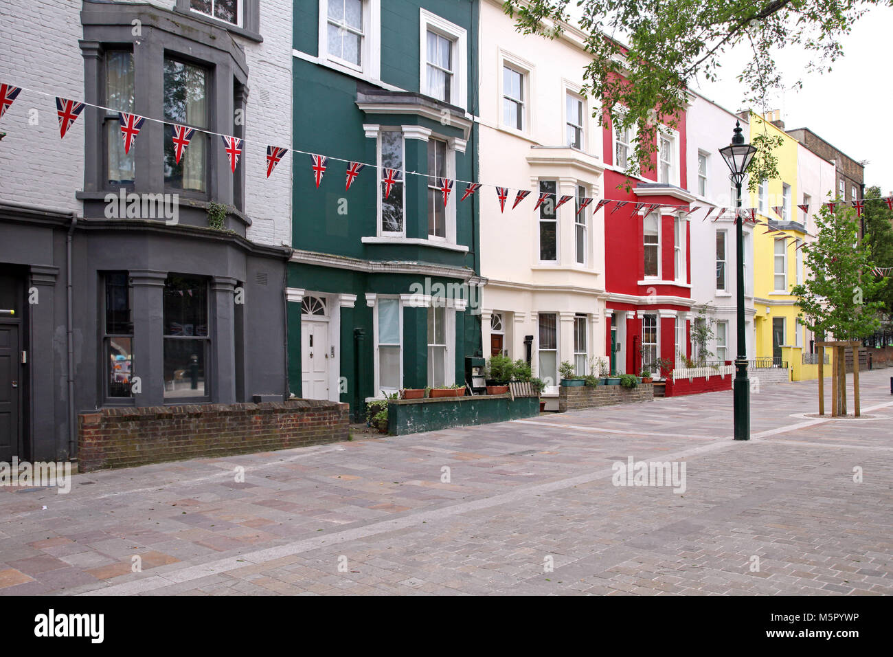 Classic London Architecture With Colorful Buildings And British Flags