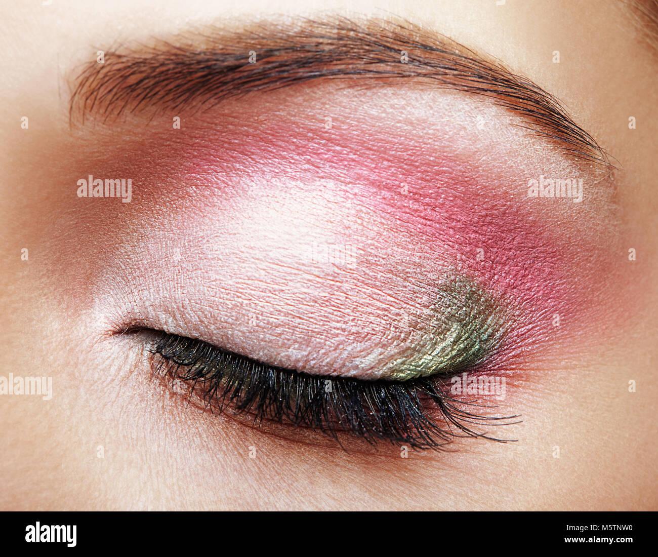 Closeup Macro Shot Of Closed Human Female Eye With Pink And Green