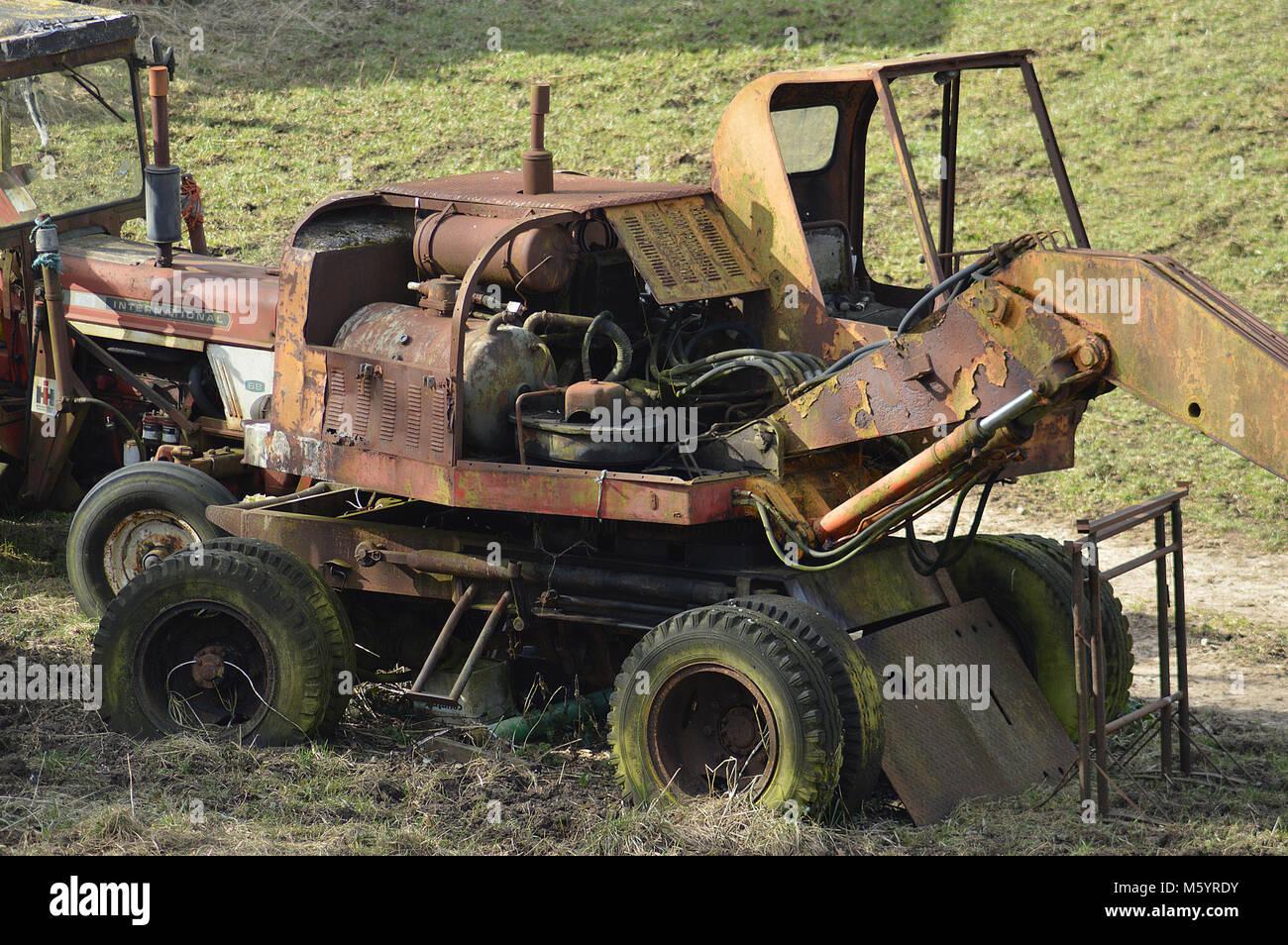 Tractor Broke Down : Old broken down tractor in stock photos