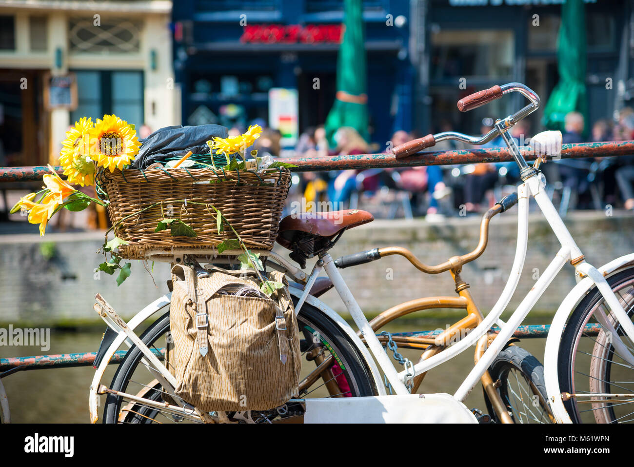 Spring View Of Old Bicycle With Flowers On A Canal Bridge In The