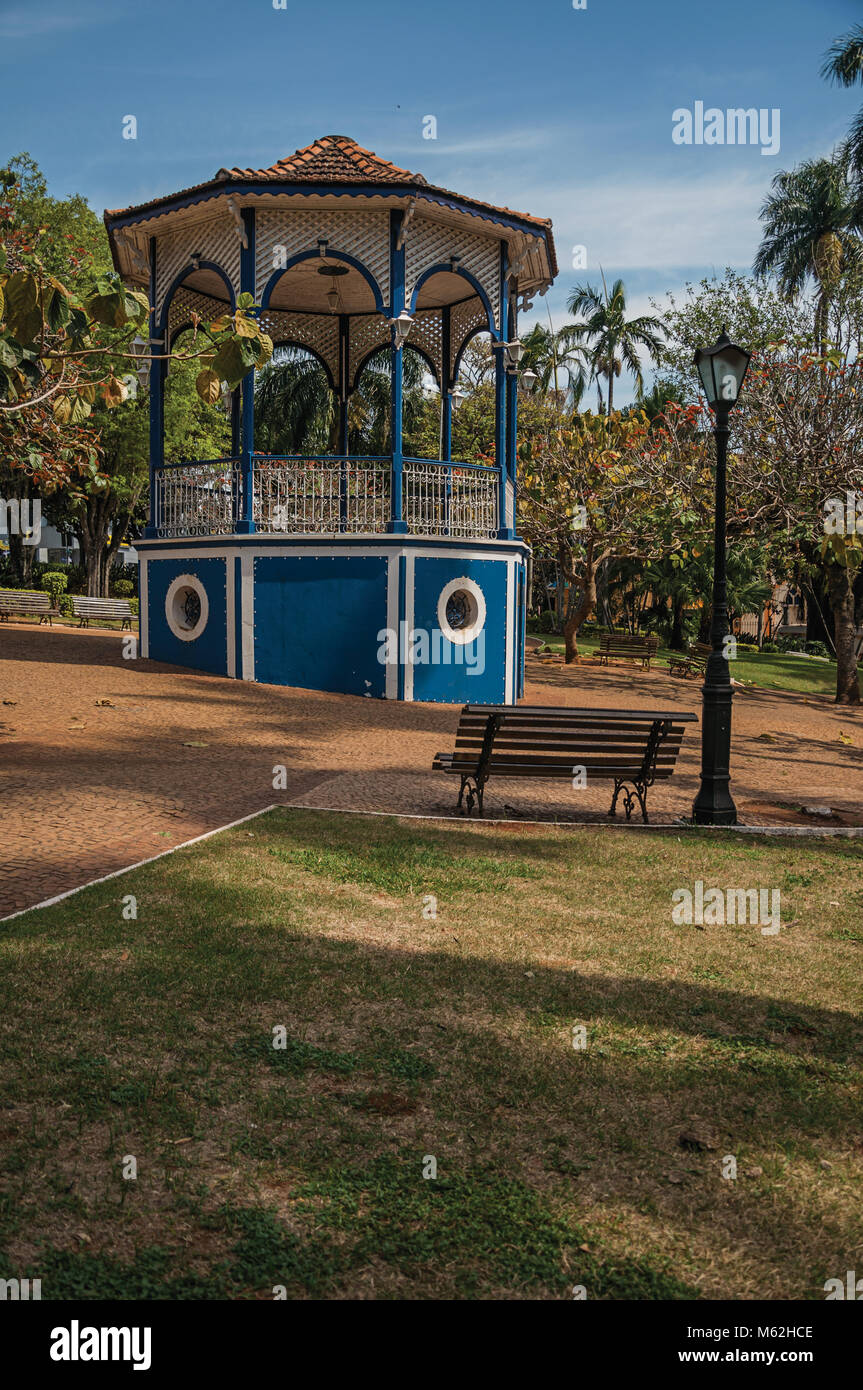 Old colorful gazebo and lighting pole in the middle of garden with ...