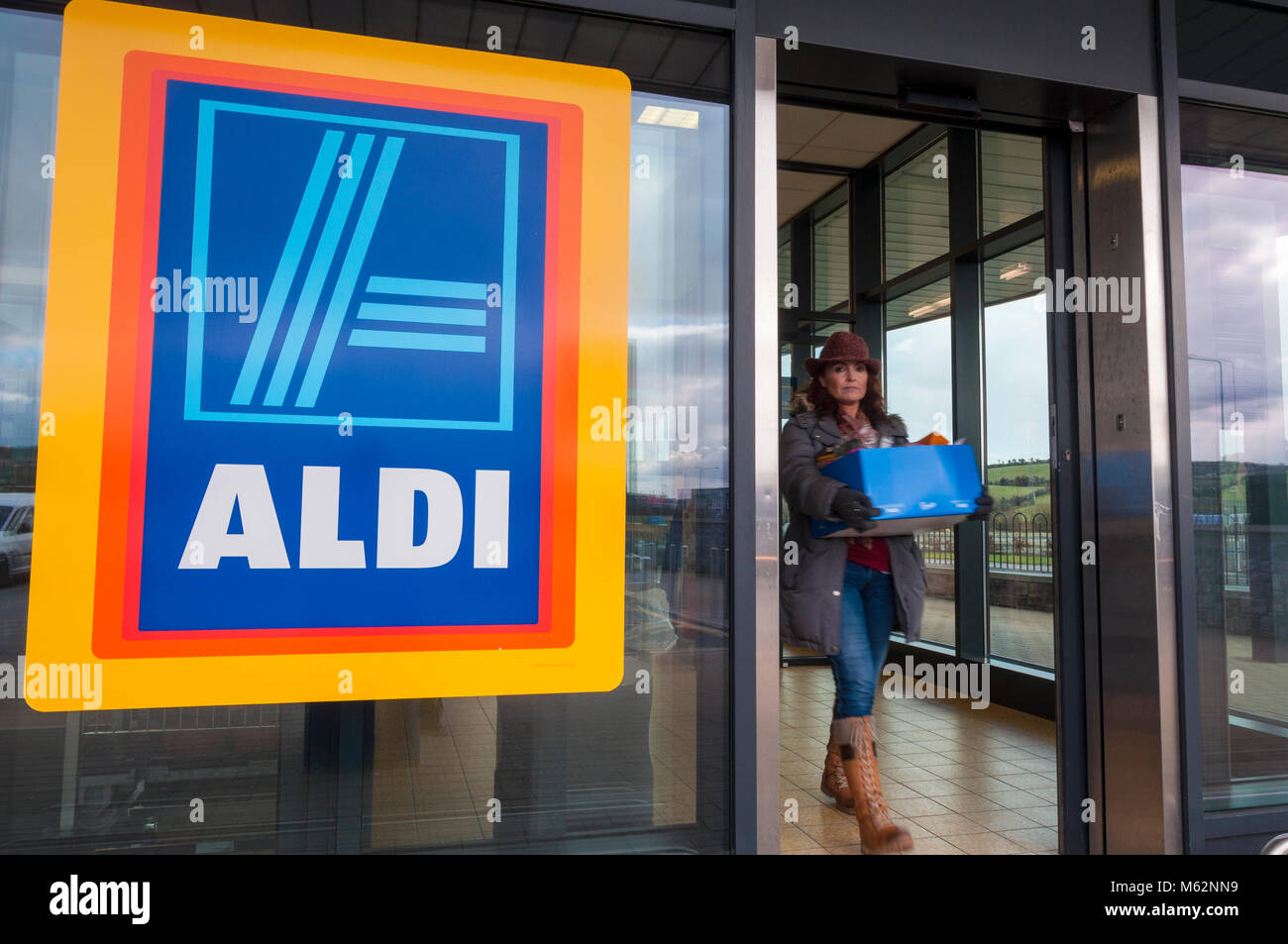 Aldi store stock photos aldi store stock images alamy woman with box of shopping leaves aldi store in letterkenny county donegal ireland biocorpaavc