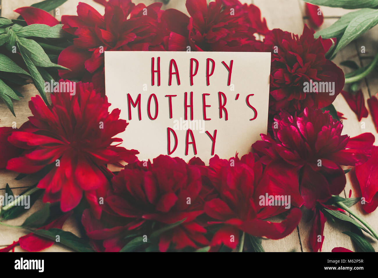 Happy mothers day text sign on craft paper card beautiful red happy mothers day text sign on craft paper card beautiful red peonies on wooden rustic background modern greeting card mothers day stylish bloomin kristyandbryce Choice Image