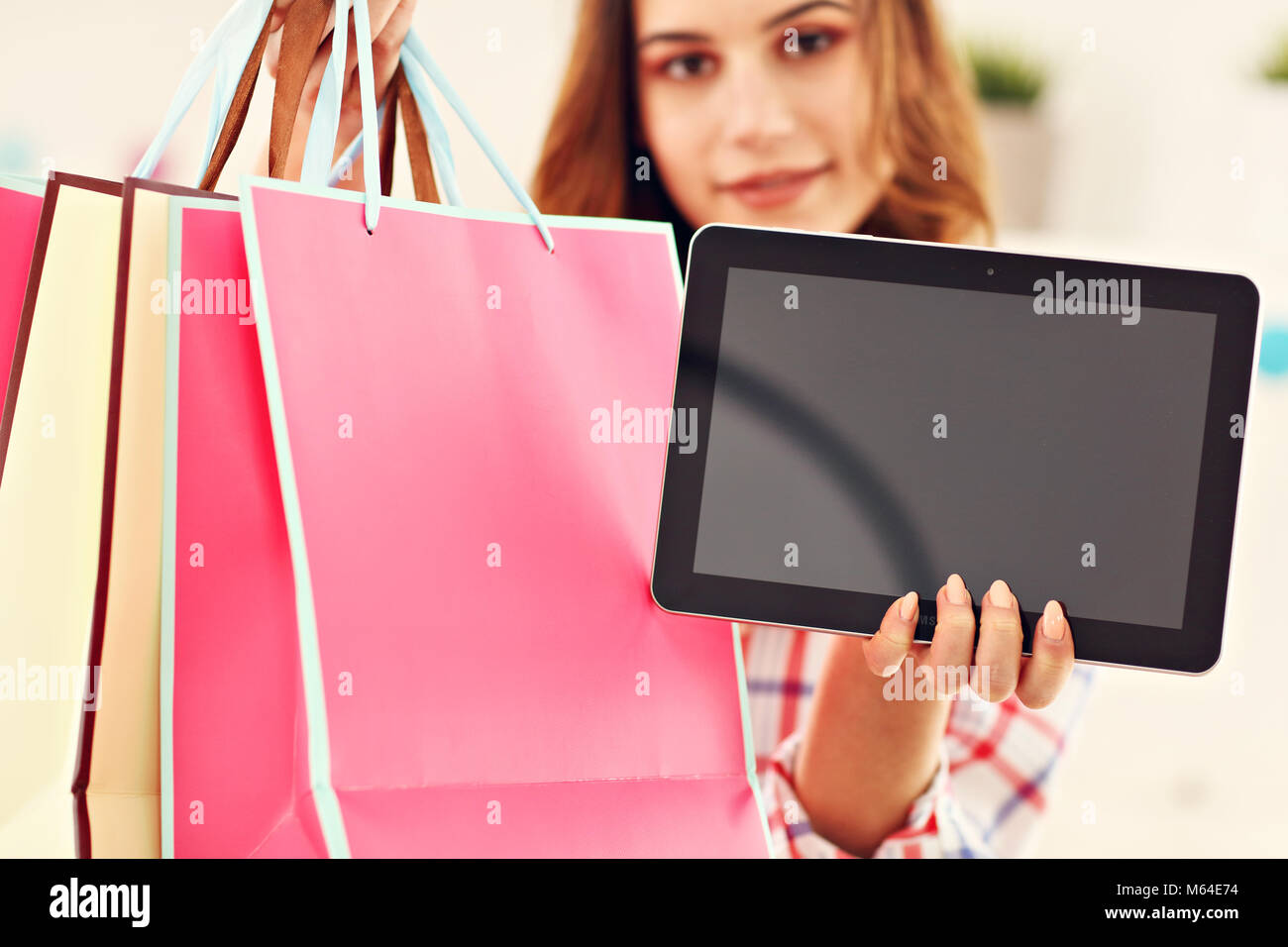 Attractive woman buying easter gifts online stock photo 175890600 attractive woman buying easter gifts online negle Gallery