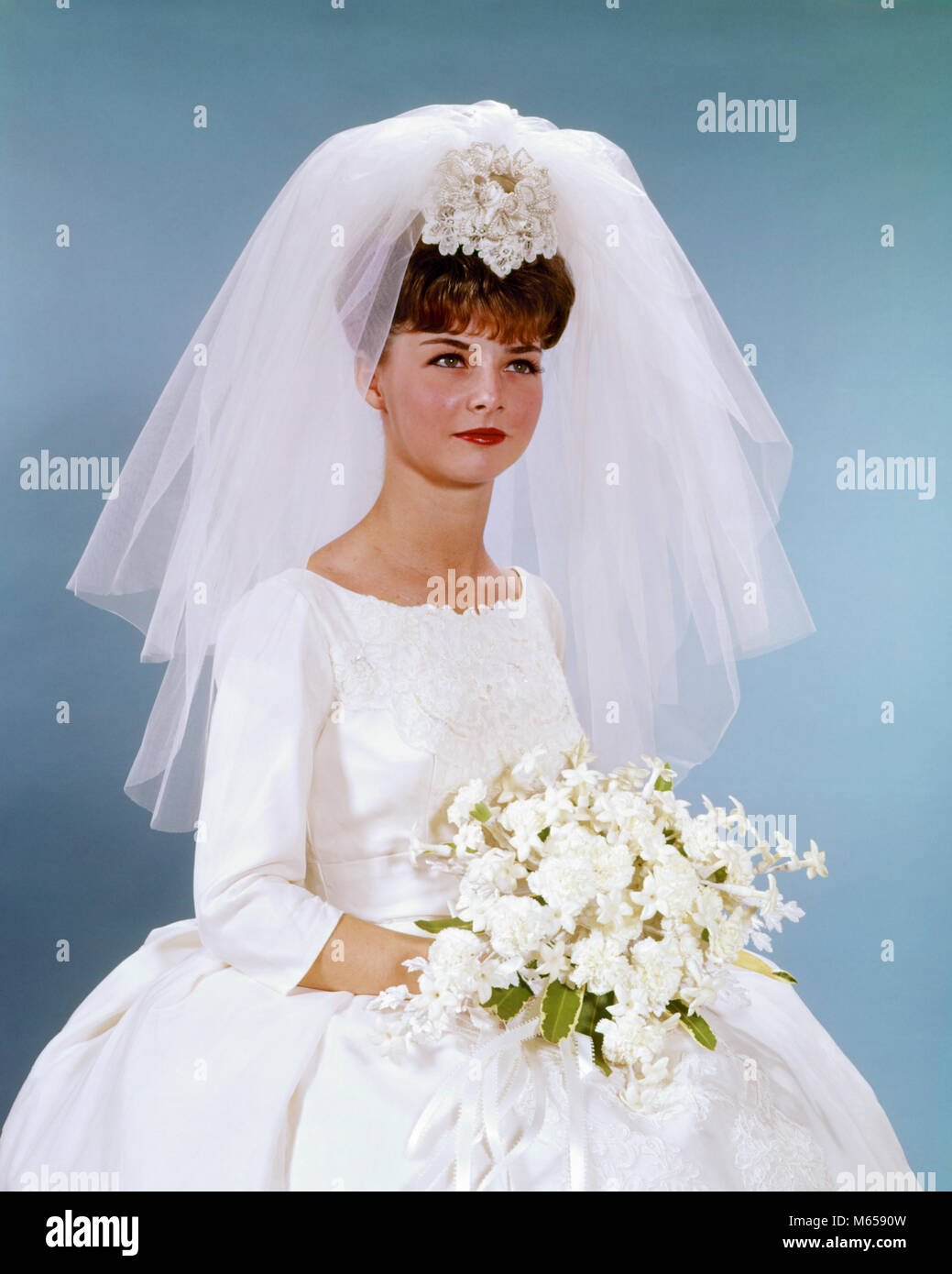 1960s PORTRAIT WOMAN BRIDE IN SIMPLE WHITE WEDDING GOWN HOLDING ...