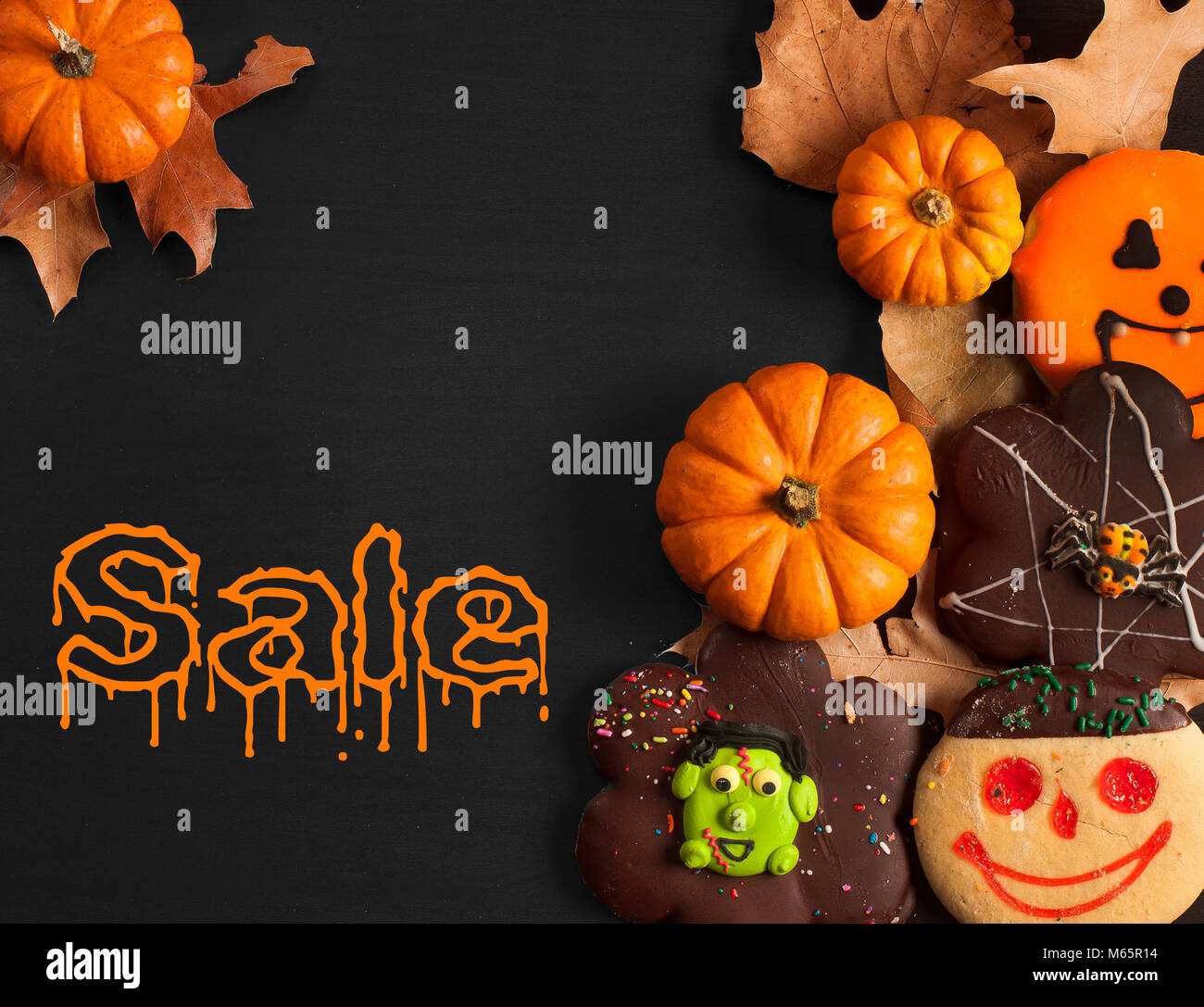 halloween sale gingerbread cookies on wooden background autumn mood