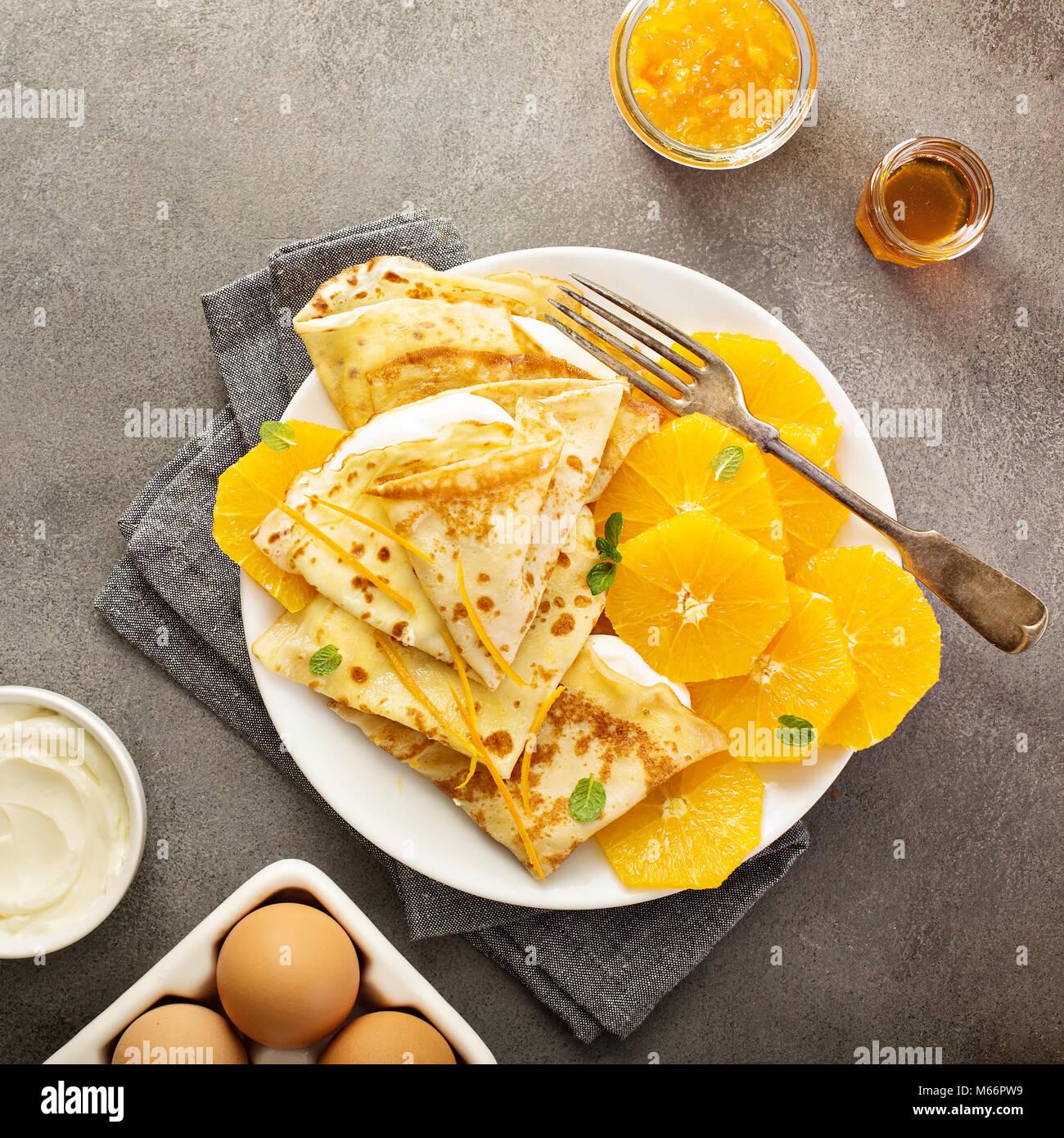 Lemon Crepes With Lemon Creme And Fruit Compote