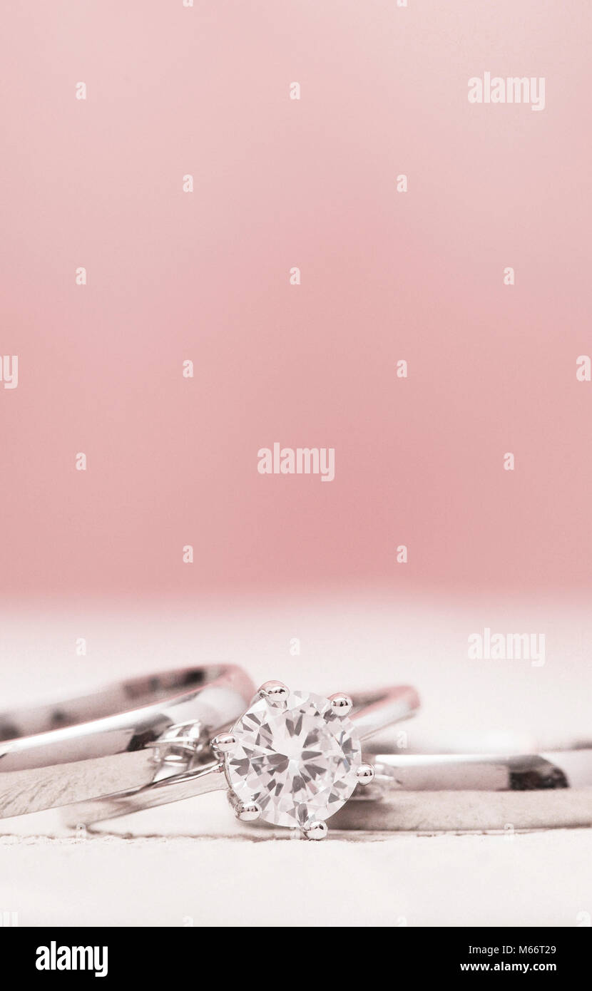 Macro View of Wedding Rings on a Wooden Table with Pink Background ...