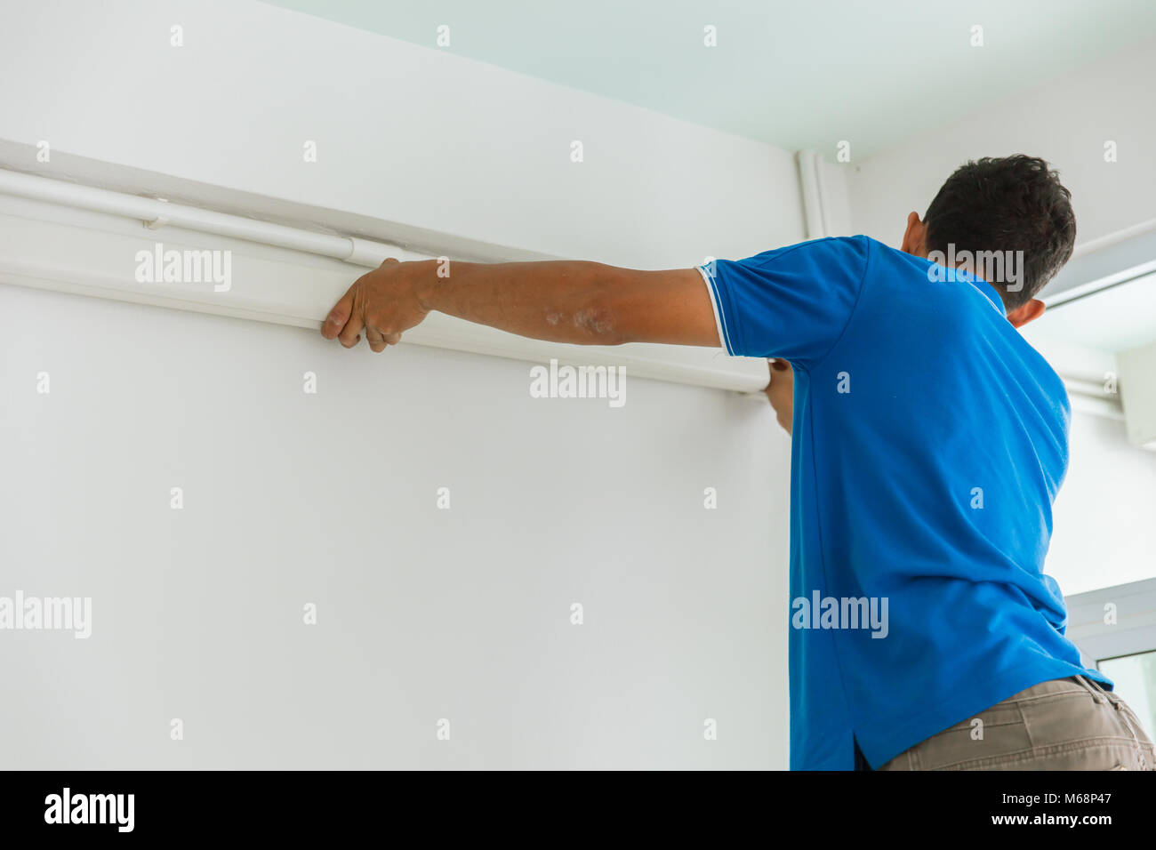 Technician install wire way cable duct pipe or PVC Cable Trunking ...