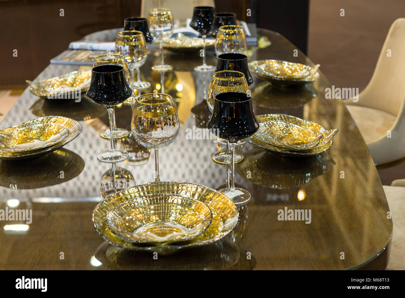 Table setting of glamorous glasses and plates in gold and black color & Table setting of glamorous glasses and plates in gold and black ...