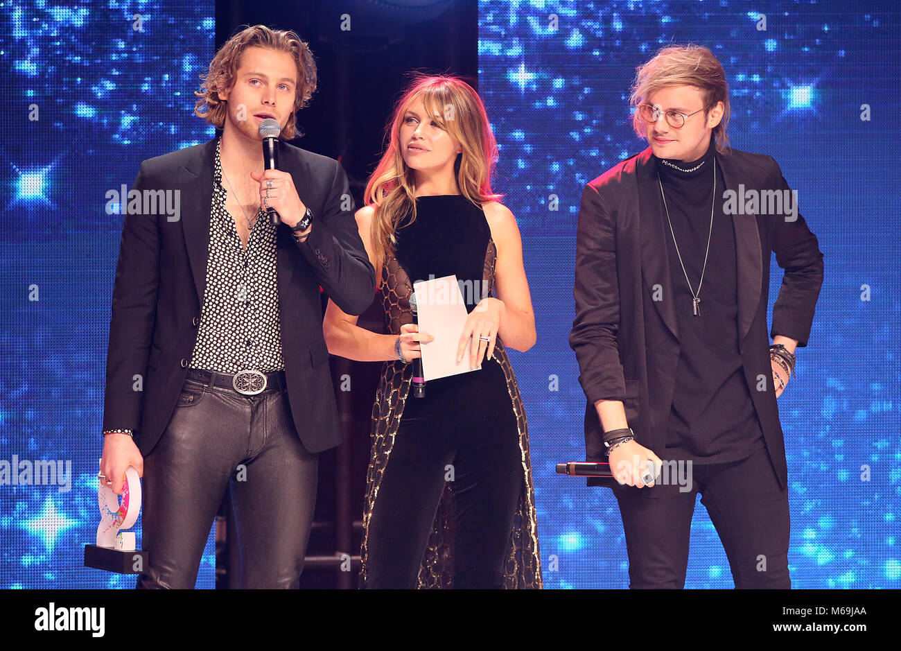 Abbey Clancy With Ashton Irwin And Michael Clifford Of 5 Seconds Of Summer On Stage During The Global Awards And New Awards Show Hosted By Global