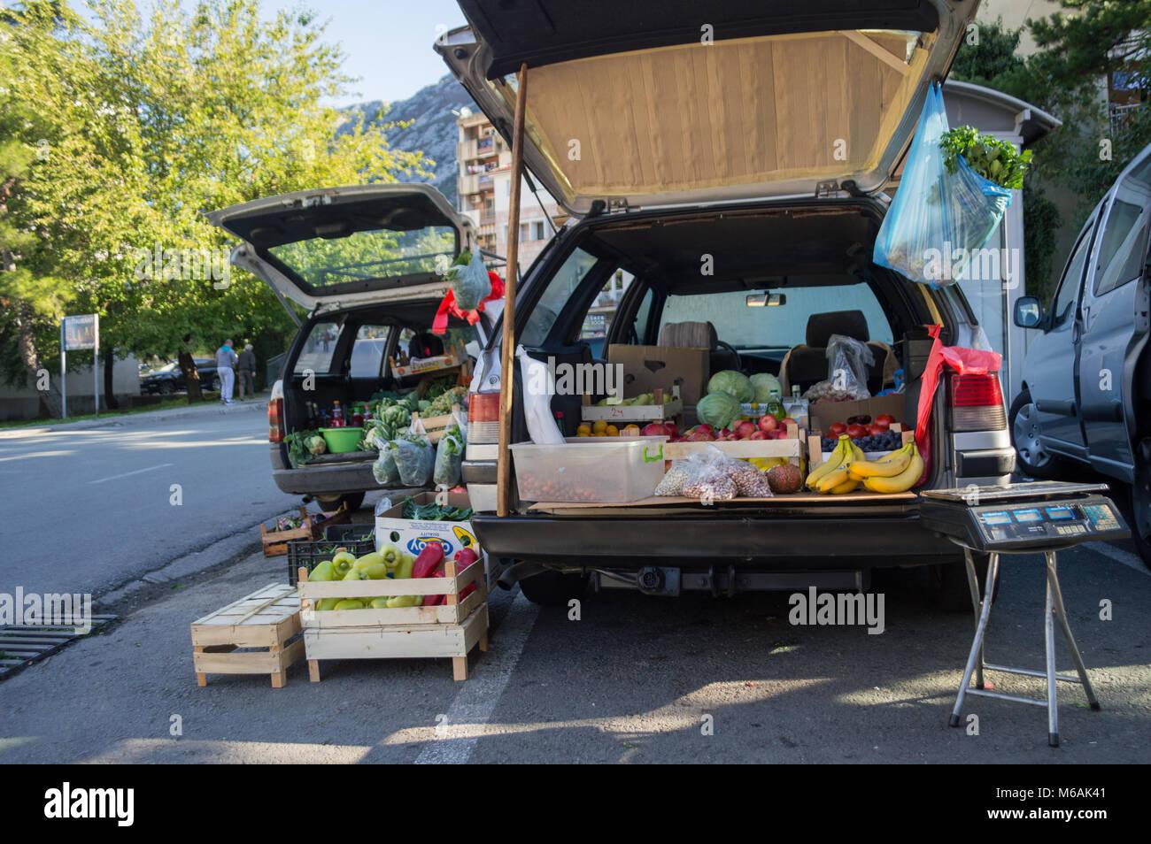 street market with car trunks in kotor montenegro stock photo