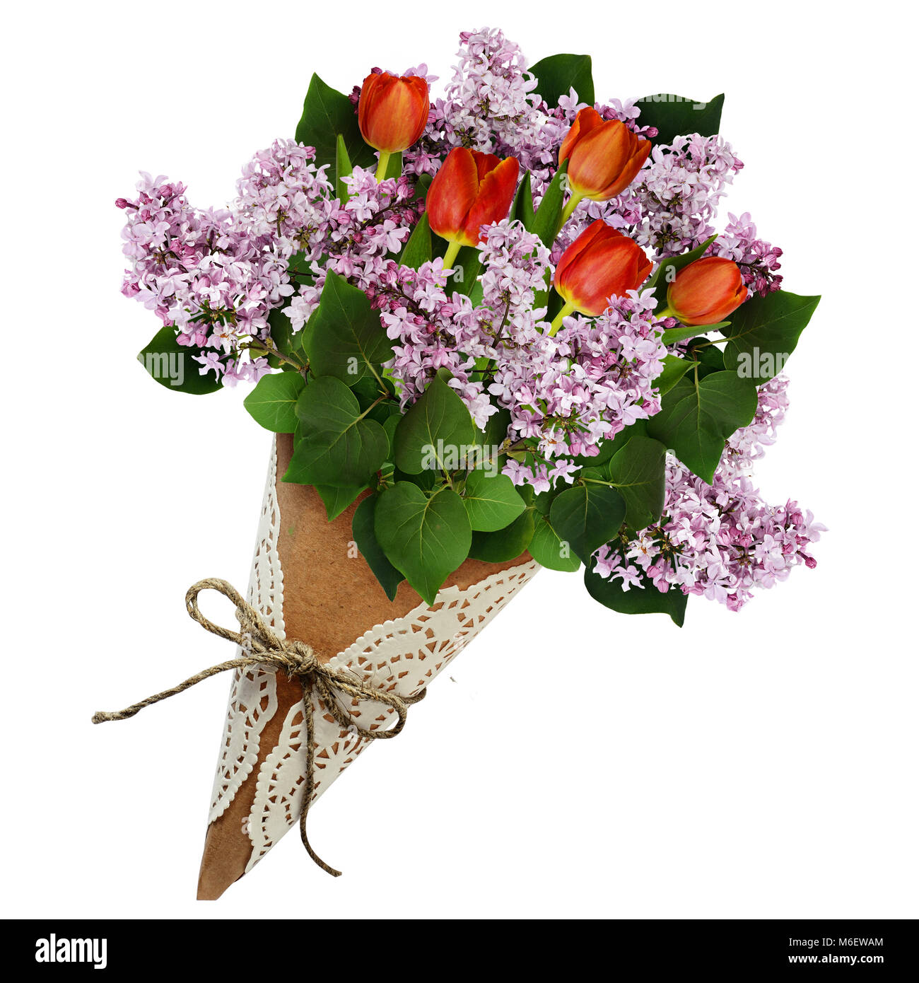 Lilac and tulip flowers bouquet in a craft paper cornet isolated on ...