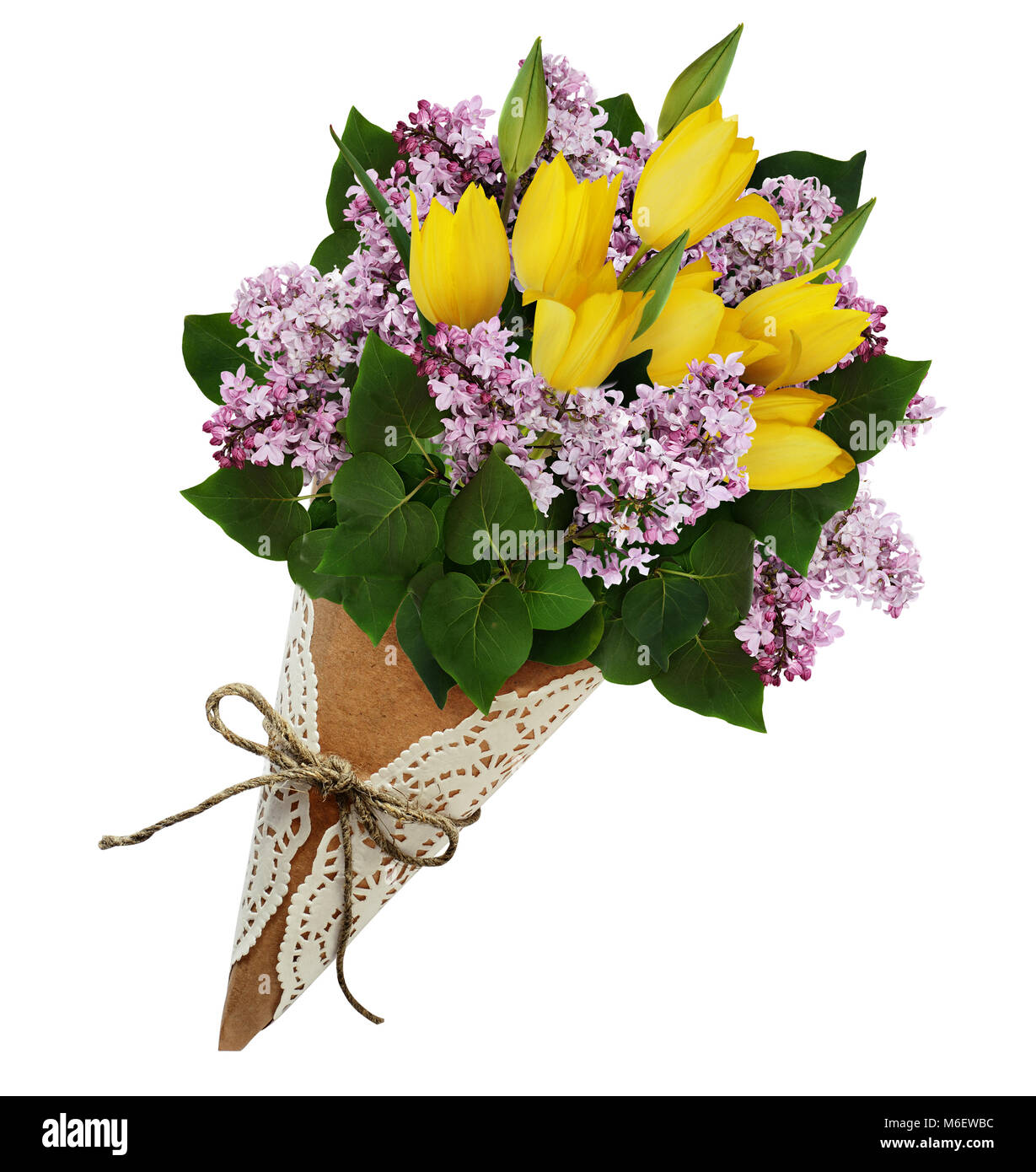 Lilac and yellow tulip flowers bouquet in a craft paper cornet Stock ...