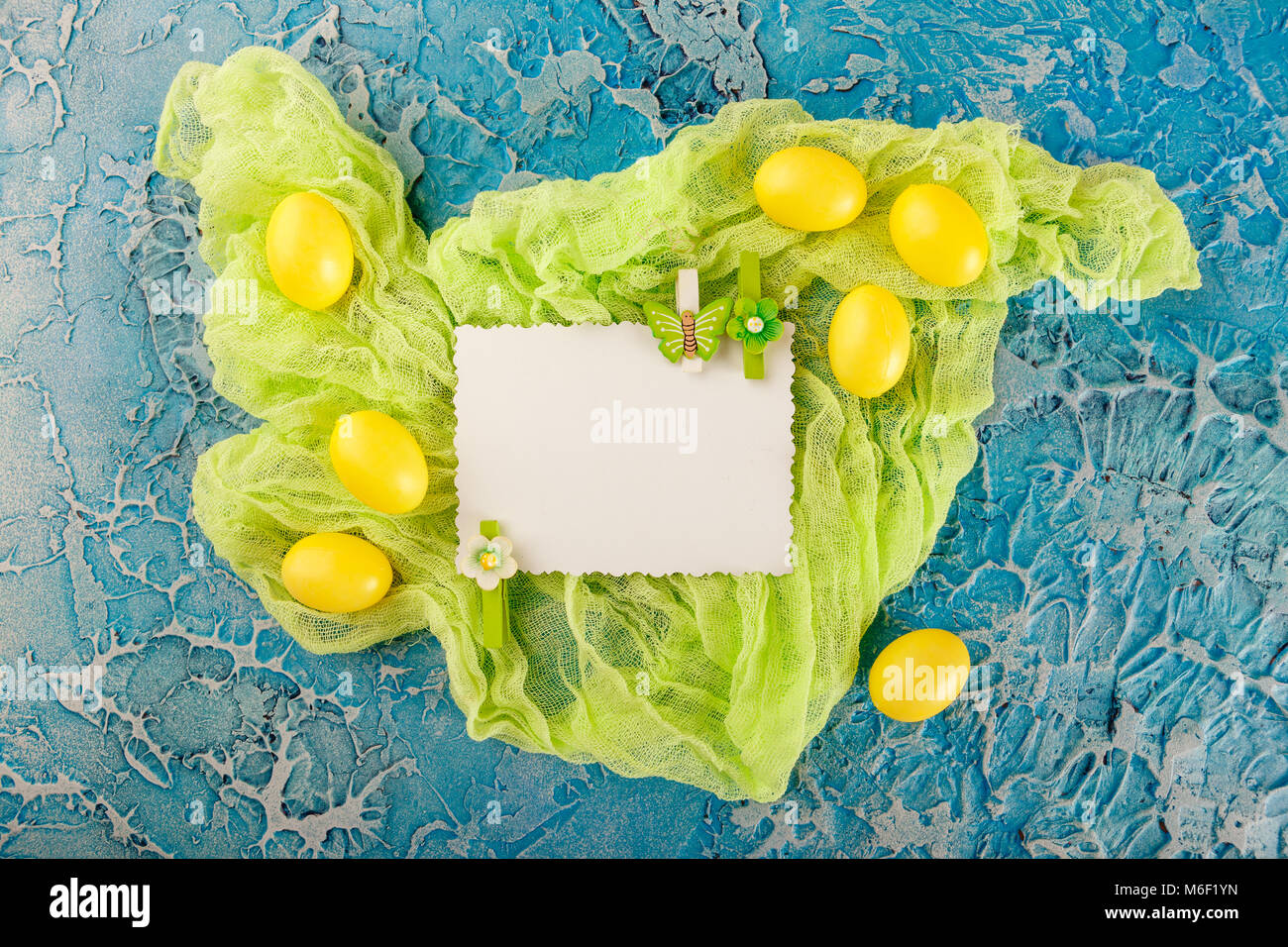 Yellow easter eggs with paper gift card on blue background stock yellow easter eggs with paper gift card on blue background negle Choice Image
