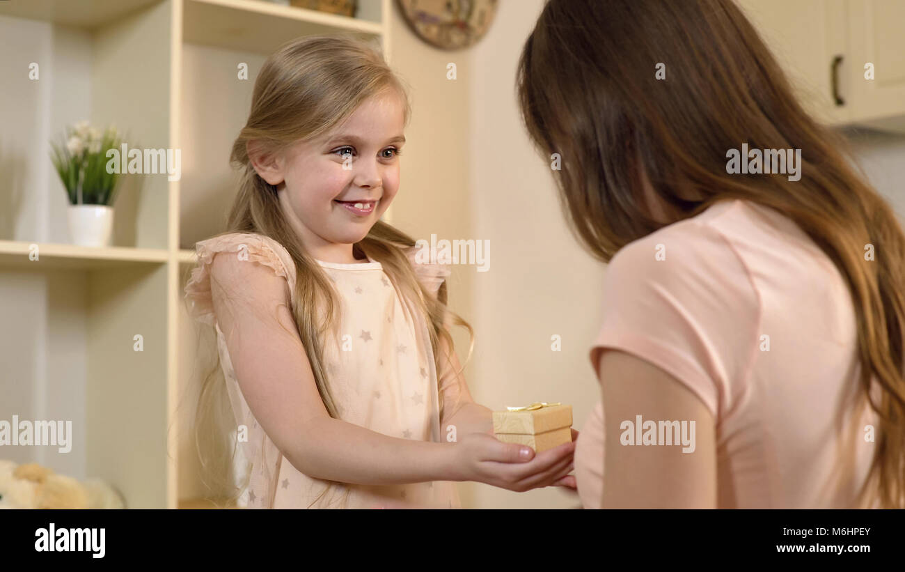 Loving Daughter Presenting Birthday Gift To Mother Tender Surprise From Child