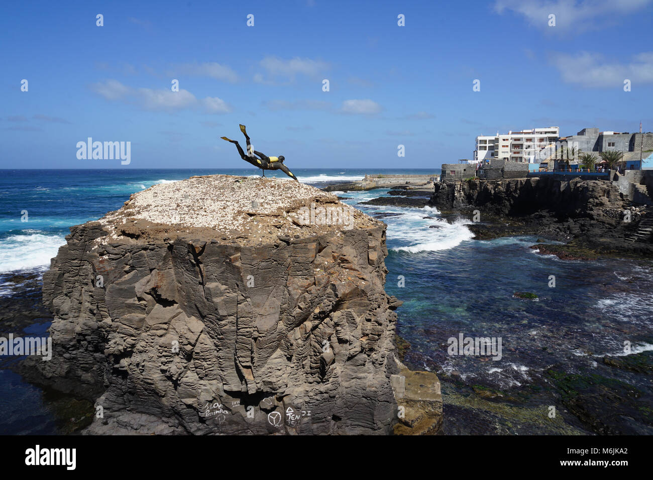 scuba diver statue on a rock facing the sea ponta do sol santo