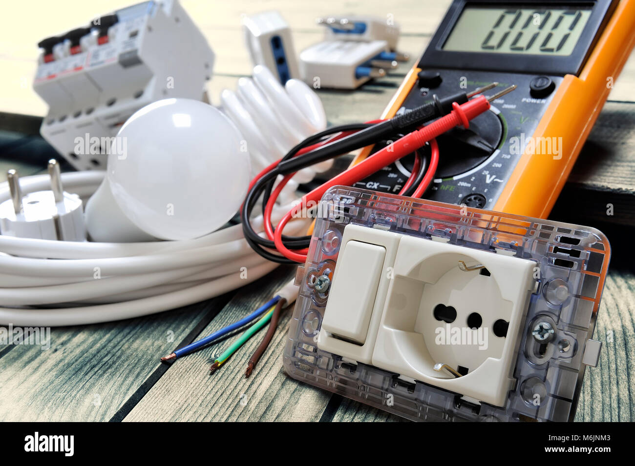Close-up of electrical socket and switch and other components for ...
